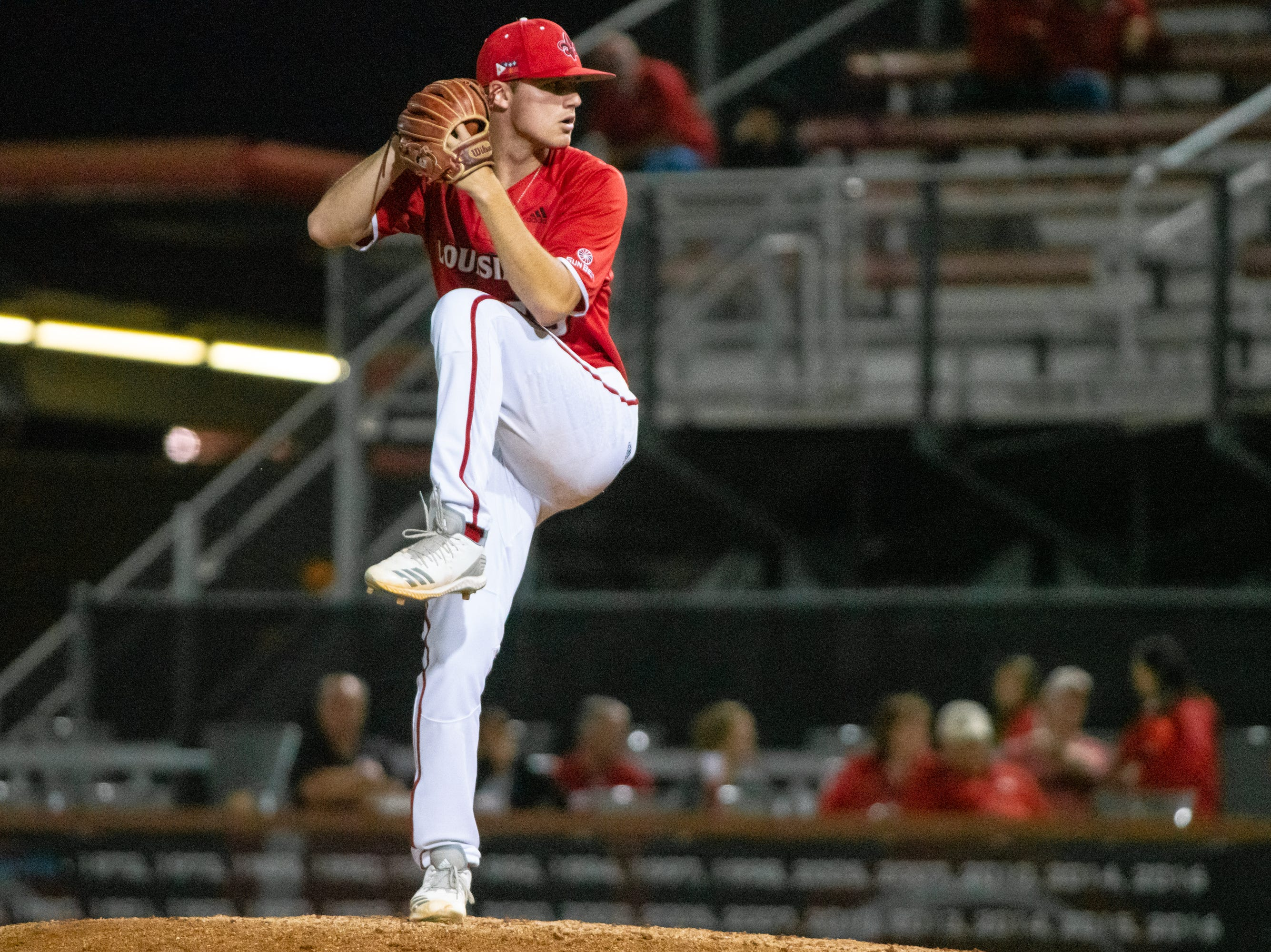 """UL's pitcher Michael Leaumont prepares a throw to the batter as the Ragin' Cajuns take on the South Alabama Jaguars at M.L. """"Tigue"""" Moore Field on Friday, April 4, 2019."""