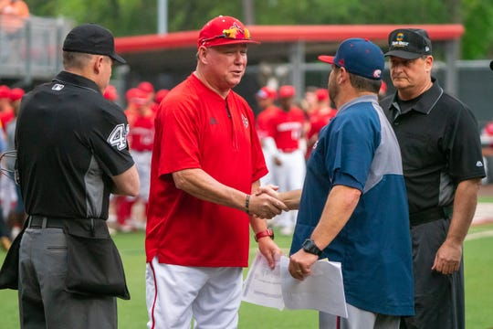 "UL's head coach Tony Robichaux meets with South Alabama's head coach Mark Calvi at home plate before the game as the Ragin' Cajuns take on the South Alabama Jaguars at M.L. ""Tigue"" Moore Field on Friday, April 4, 2019."
