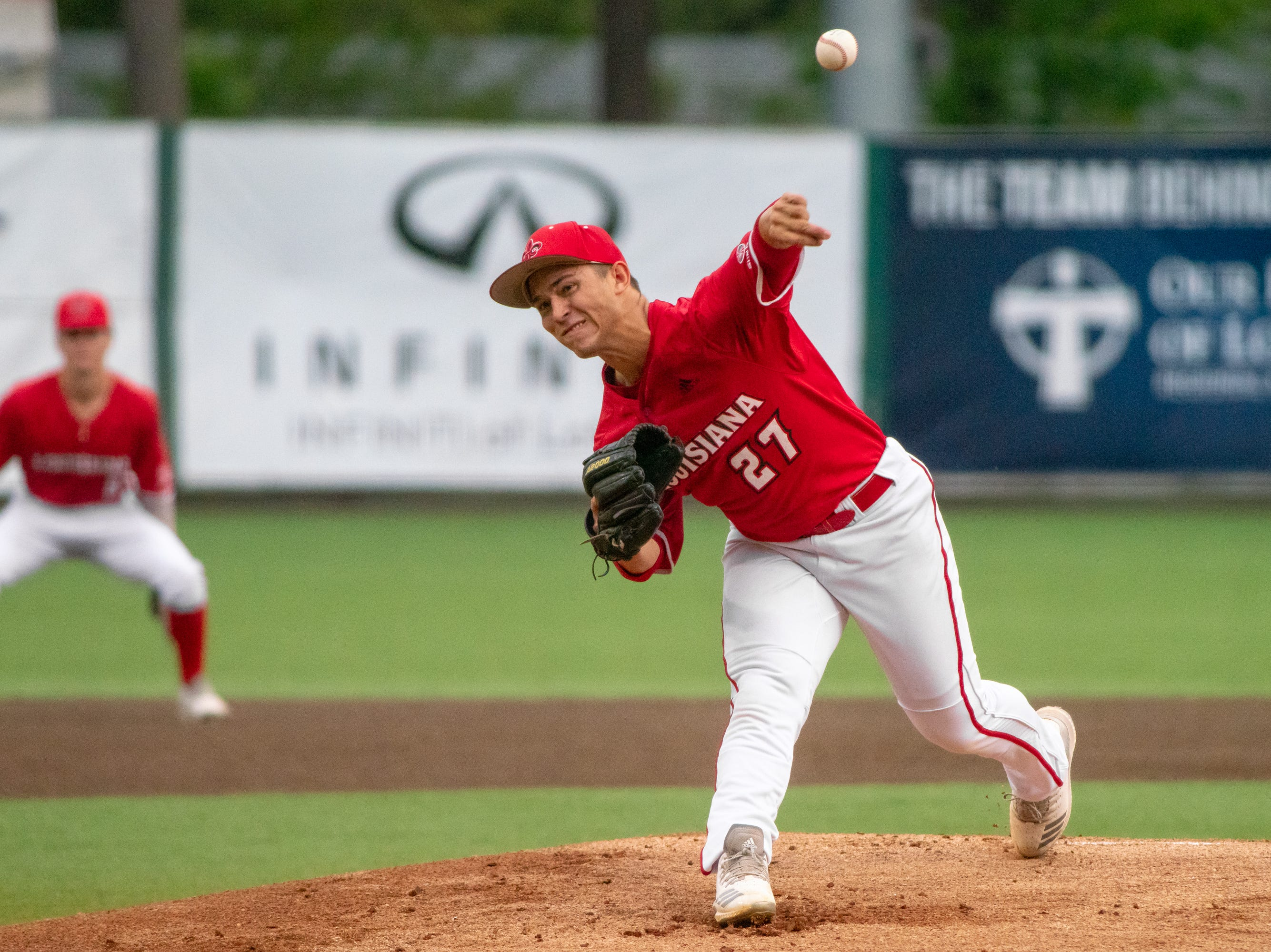 """UL's Austin Perrin pitches from the mound as the Ragin' Cajuns take on the South Alabama Jaguars at M.L. """"Tigue"""" Moore Field on Friday, April 4, 2019."""