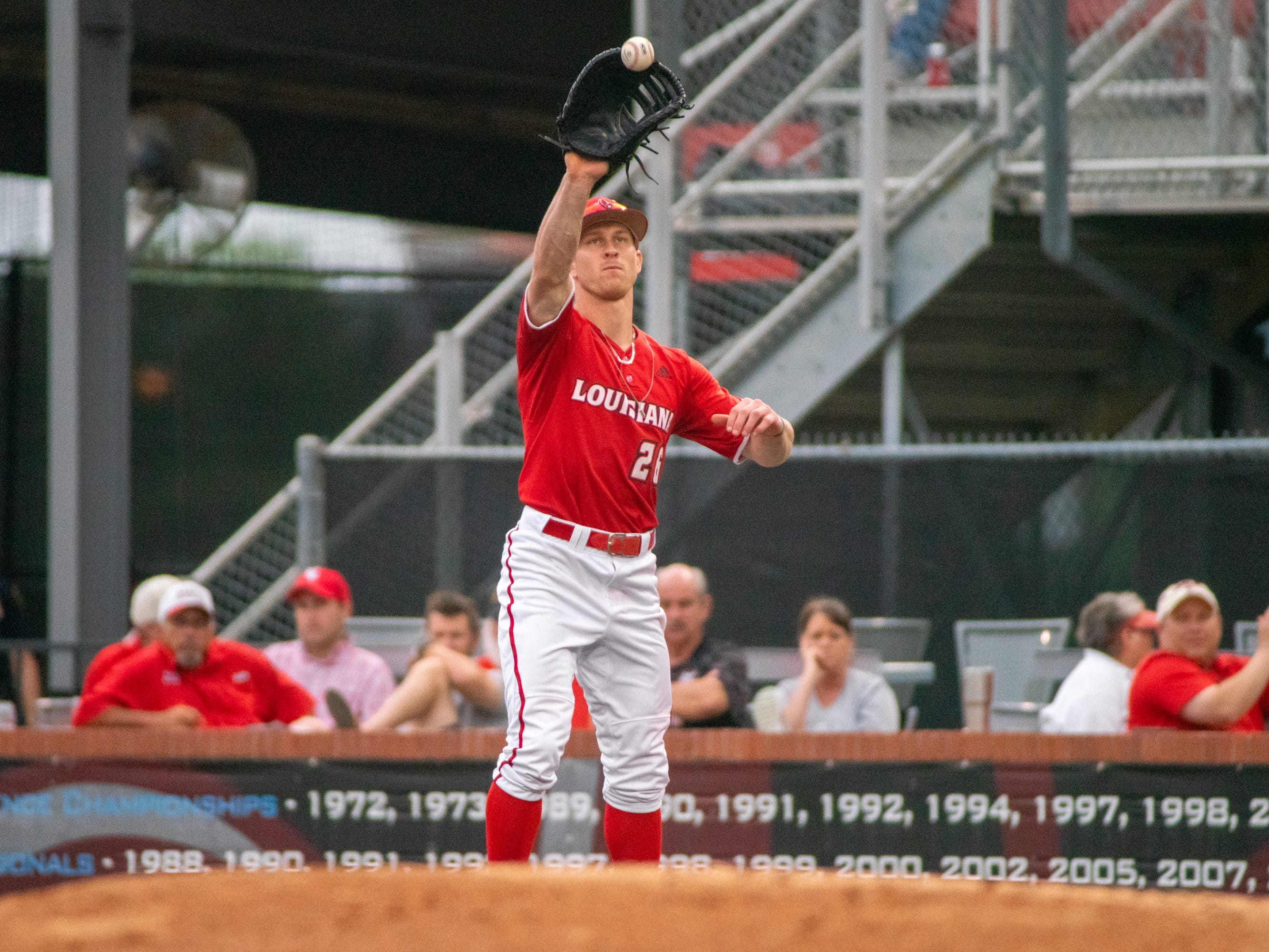 """UL's Daniel Lahare makes a catch at first base to get the runner out as the Ragin' Cajuns take on the South Alabama Jaguars at M.L. """"Tigue"""" Moore Field on Friday, April 4, 2019."""