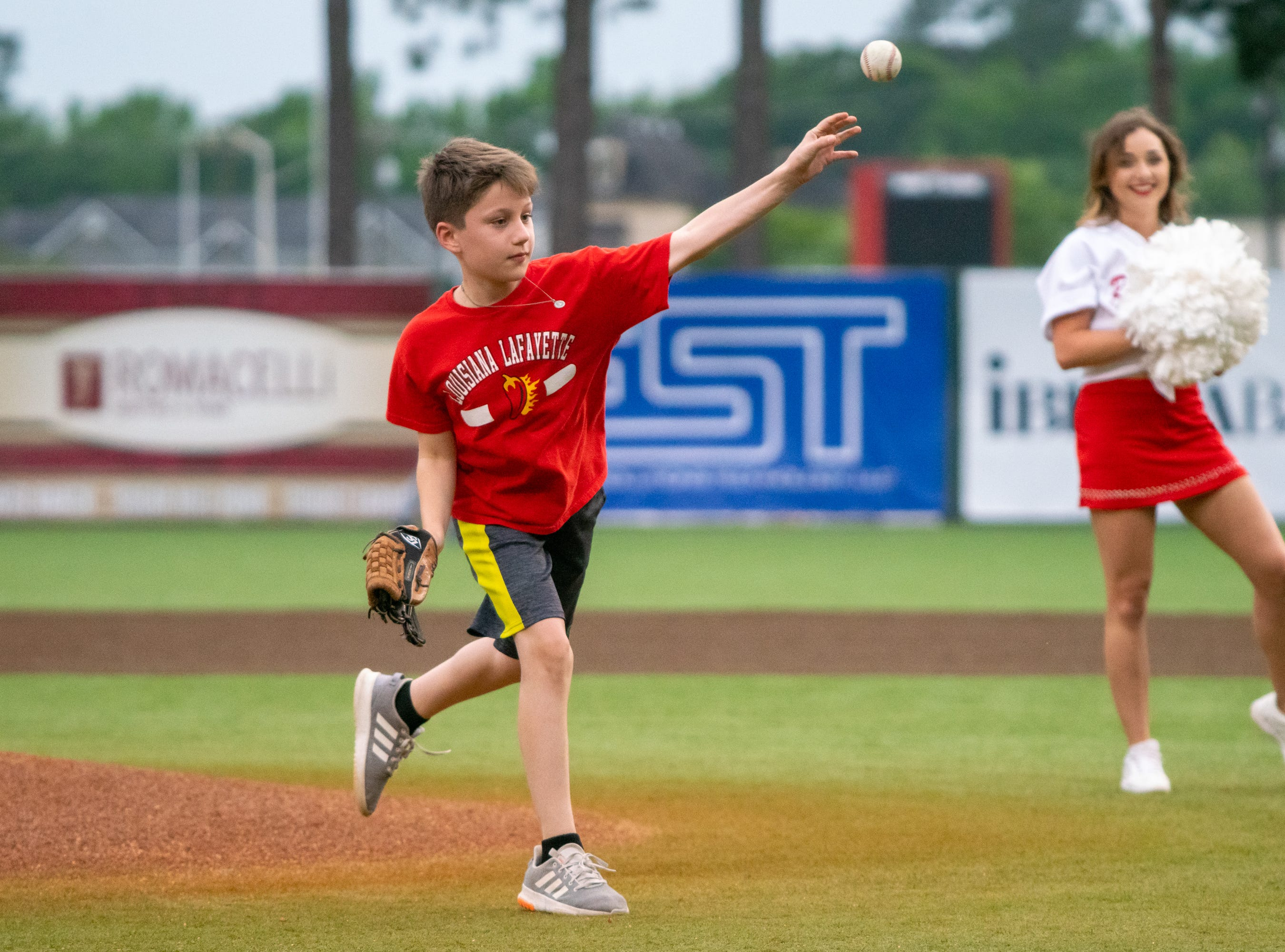 """The first pitch is thrown before the game as the Ragin' Cajuns take on the South Alabama Jaguars at M.L. """"Tigue"""" Moore Field on Friday, April 4, 2019."""