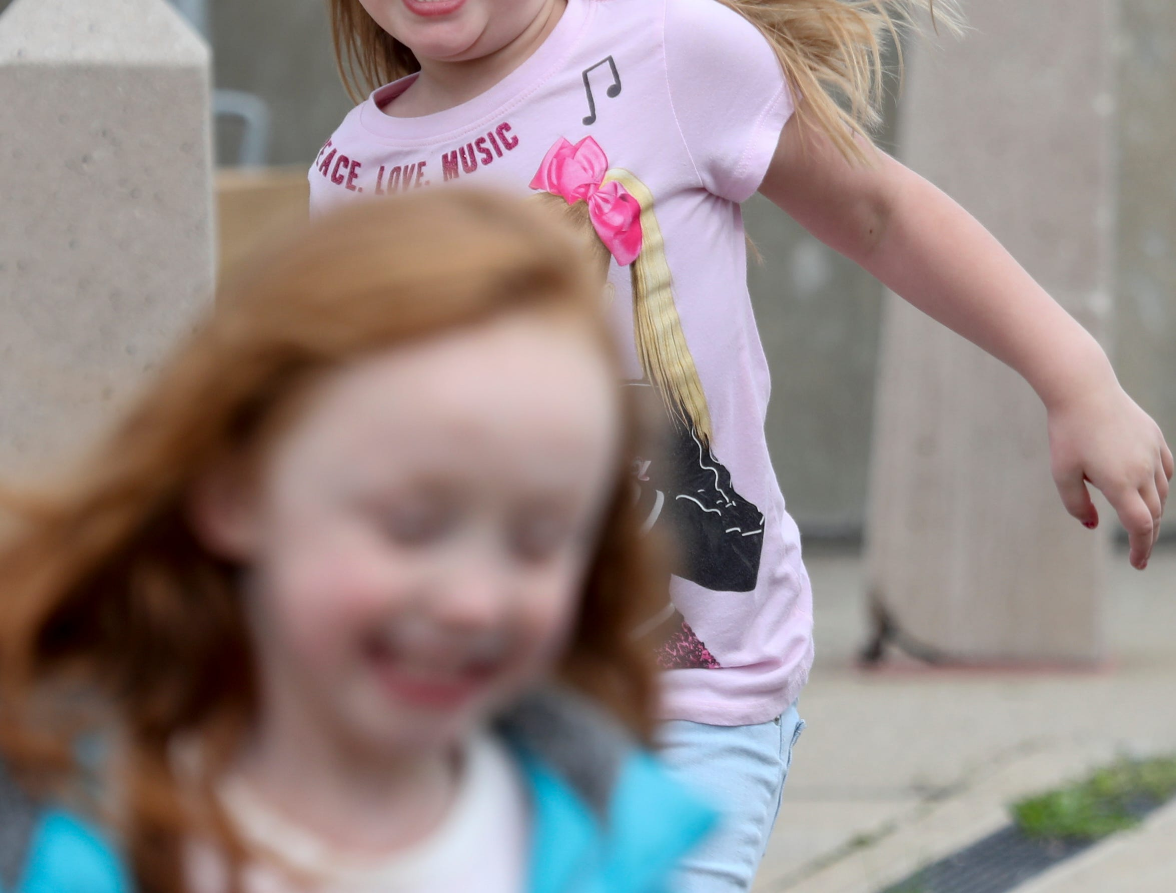 Aubree Watson chases Aianna Lynn at Thunder Over Louisville on April 13.