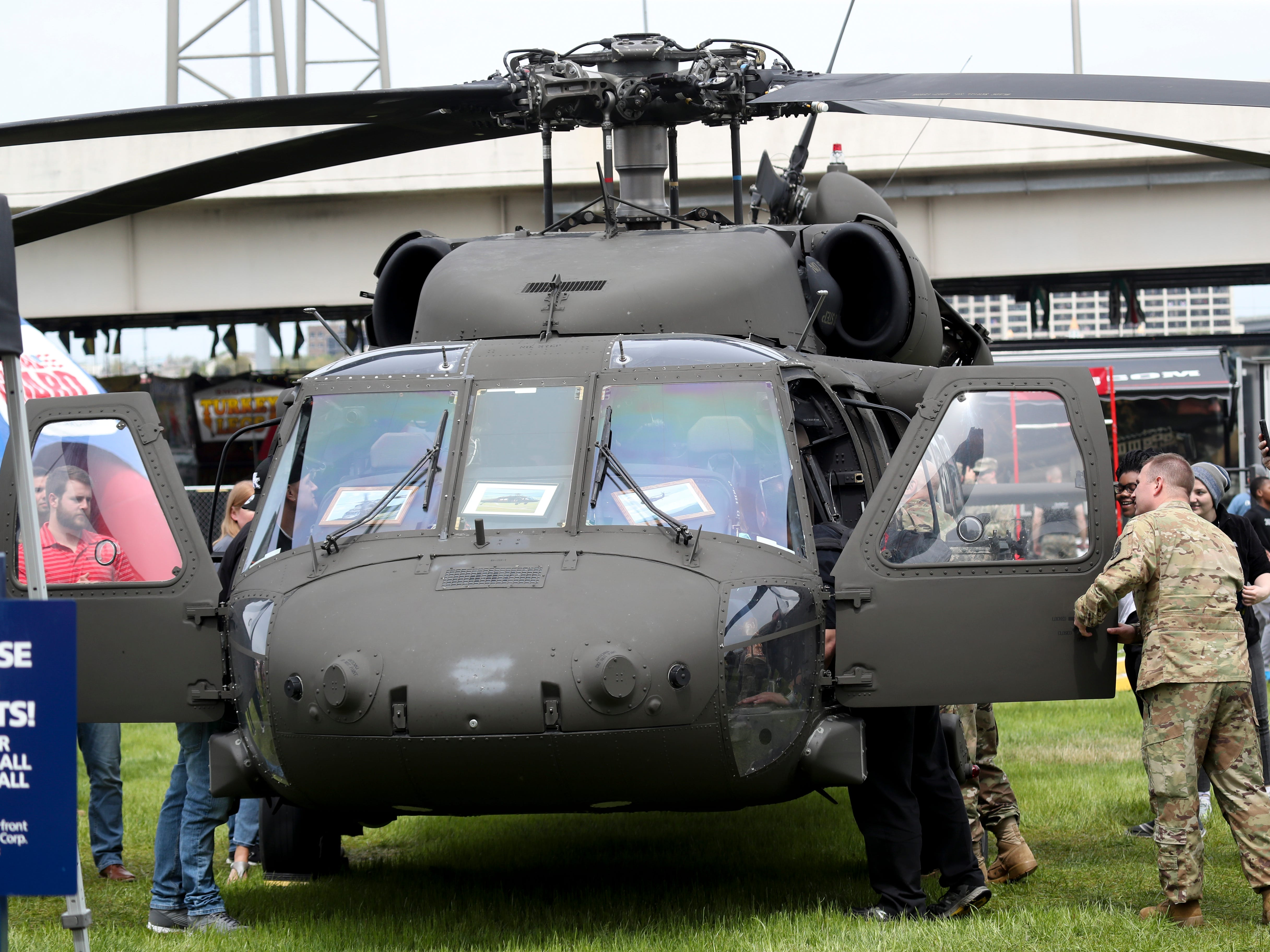 People visit the Blackhawk helicopter on display at Thunder Over Louisville on April 13.