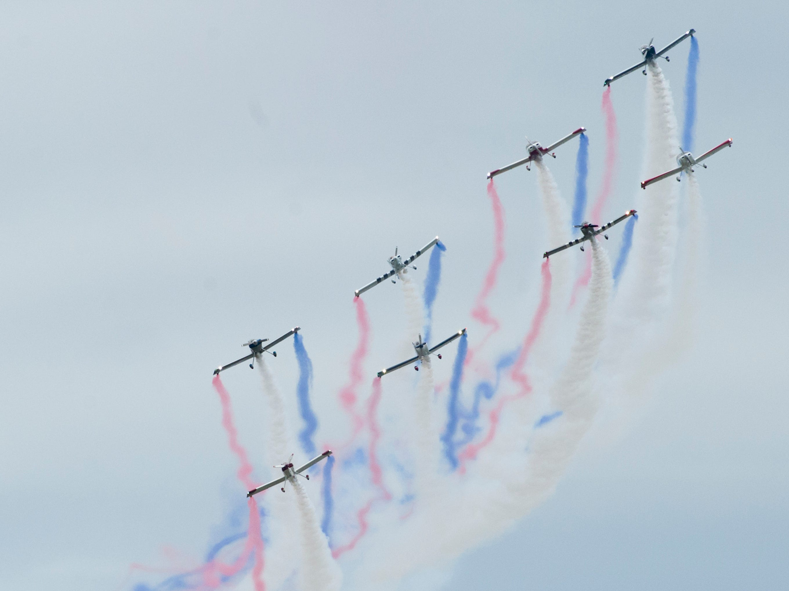 KC Flight, Kansas City's largest home grown civilian formation team, blows color smoke trails from their RV-4's at the 2019 Thunder Over Louisville Air Show.13 April 2019