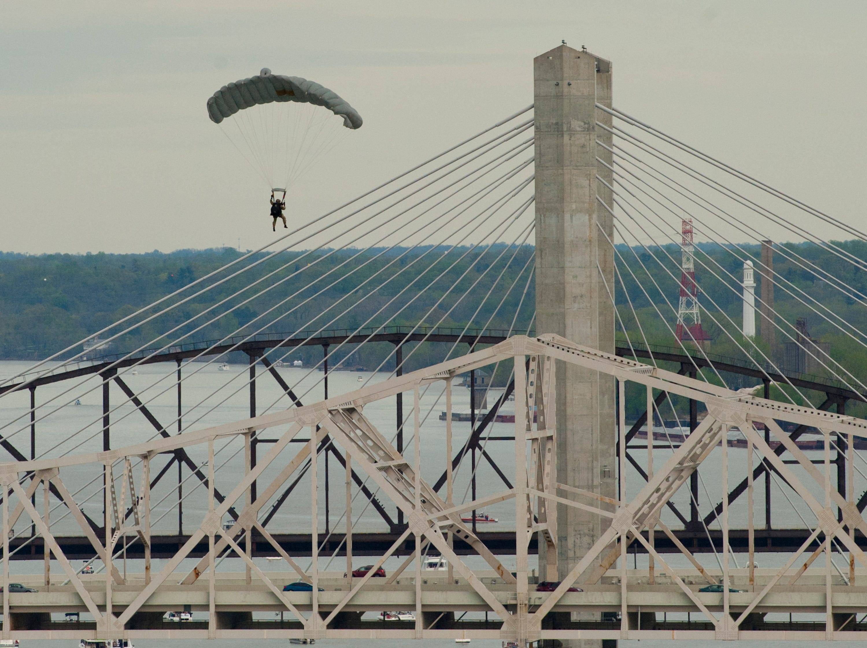 Kentucky Air National Guard's 123rd Airlift Wing flies a C-130 and Special tactics High Altitude Low Opening (HALO) air dropped parachutists at the 2019 Thunder Over Louisville Air Show.13 April 2019