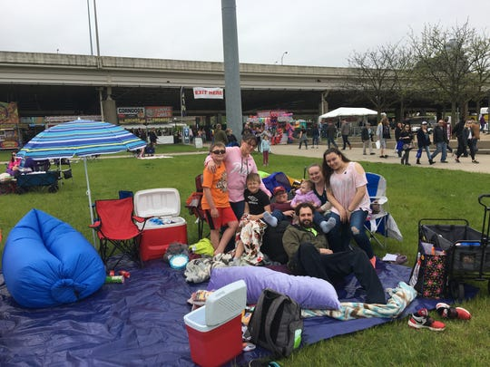 Fifteen-month-old Sophie Switzer, center, and her family prepare to watch Thunder Over Louisville.