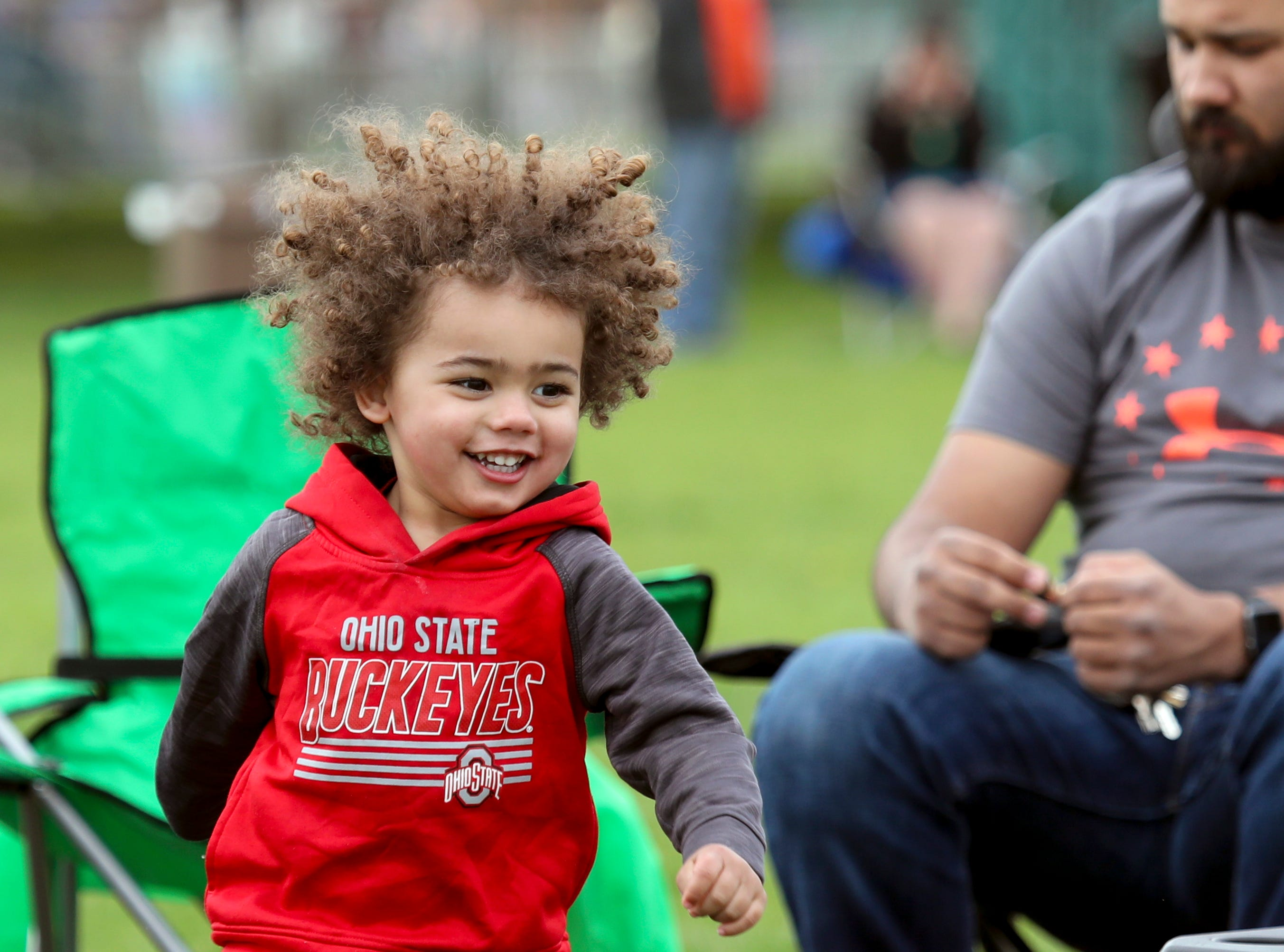 Walker Ludwig enjoys the early afternoon as his family waits for the Thunder Over Louisville airshow to being on April 13.