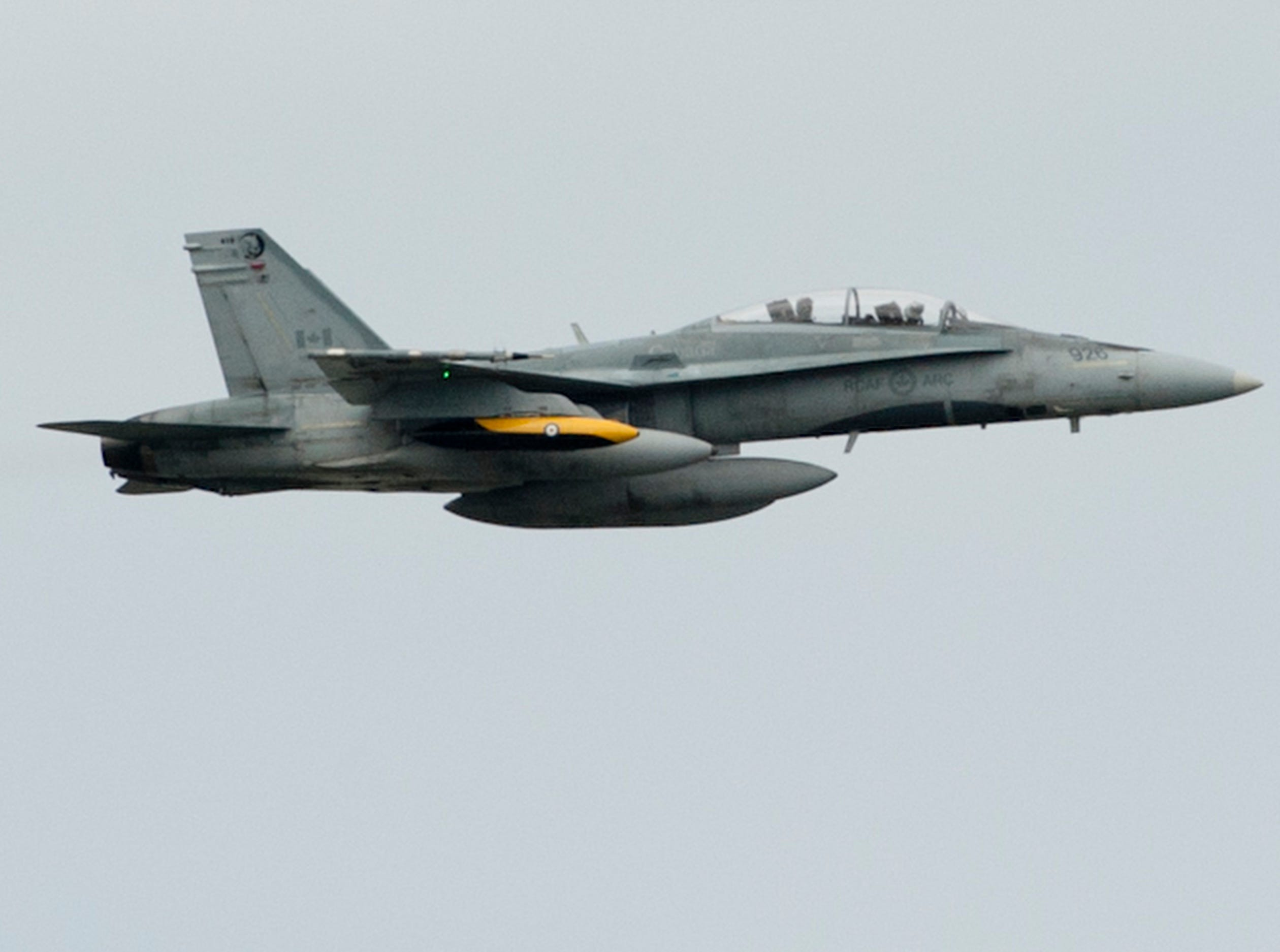 A CF-18 flown by the Royal Canadian Air Force's 401 Tactical Fighter Squadron soars by at the 2019 Thunder Over Louisville Air Show.13 April 2019