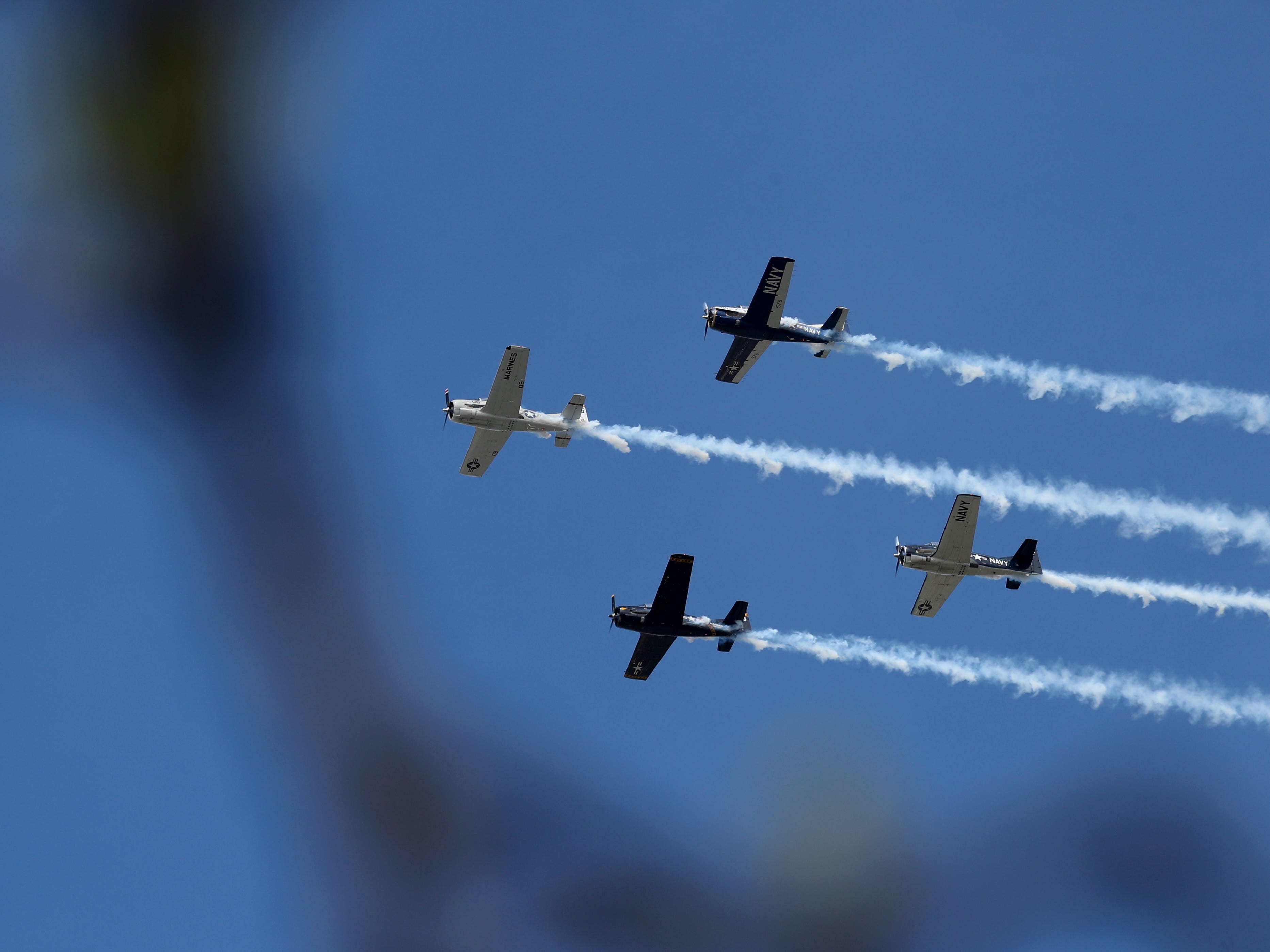 A T-28 from from the Trojan Thunder squad entertains the crowd at Thunder Over Louisville on April 13.