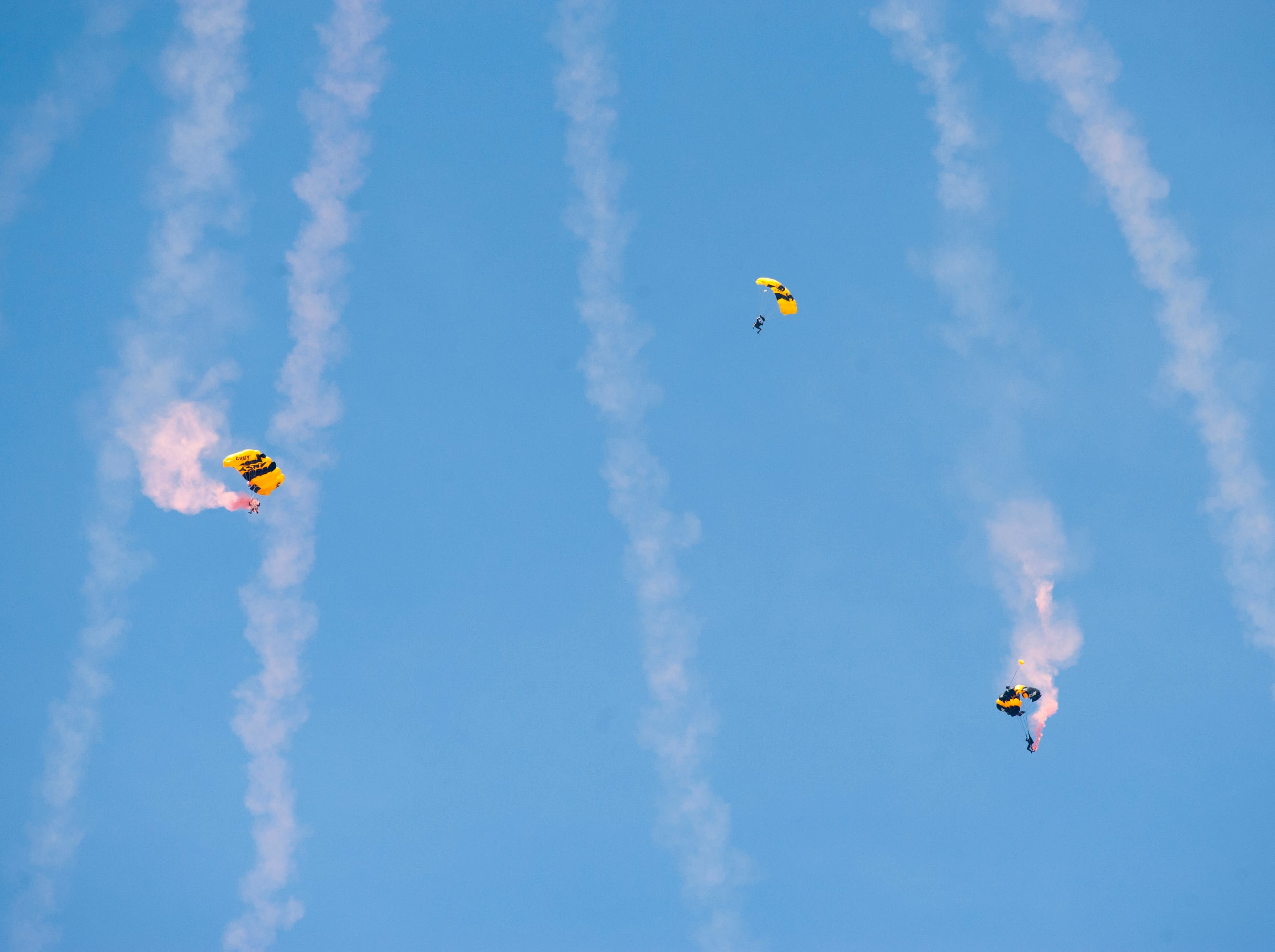 The U.S. Army Golden Knights parachute toward the Ohio River at the 2019 Thunder Over Louisville Air Show.13 April 2019