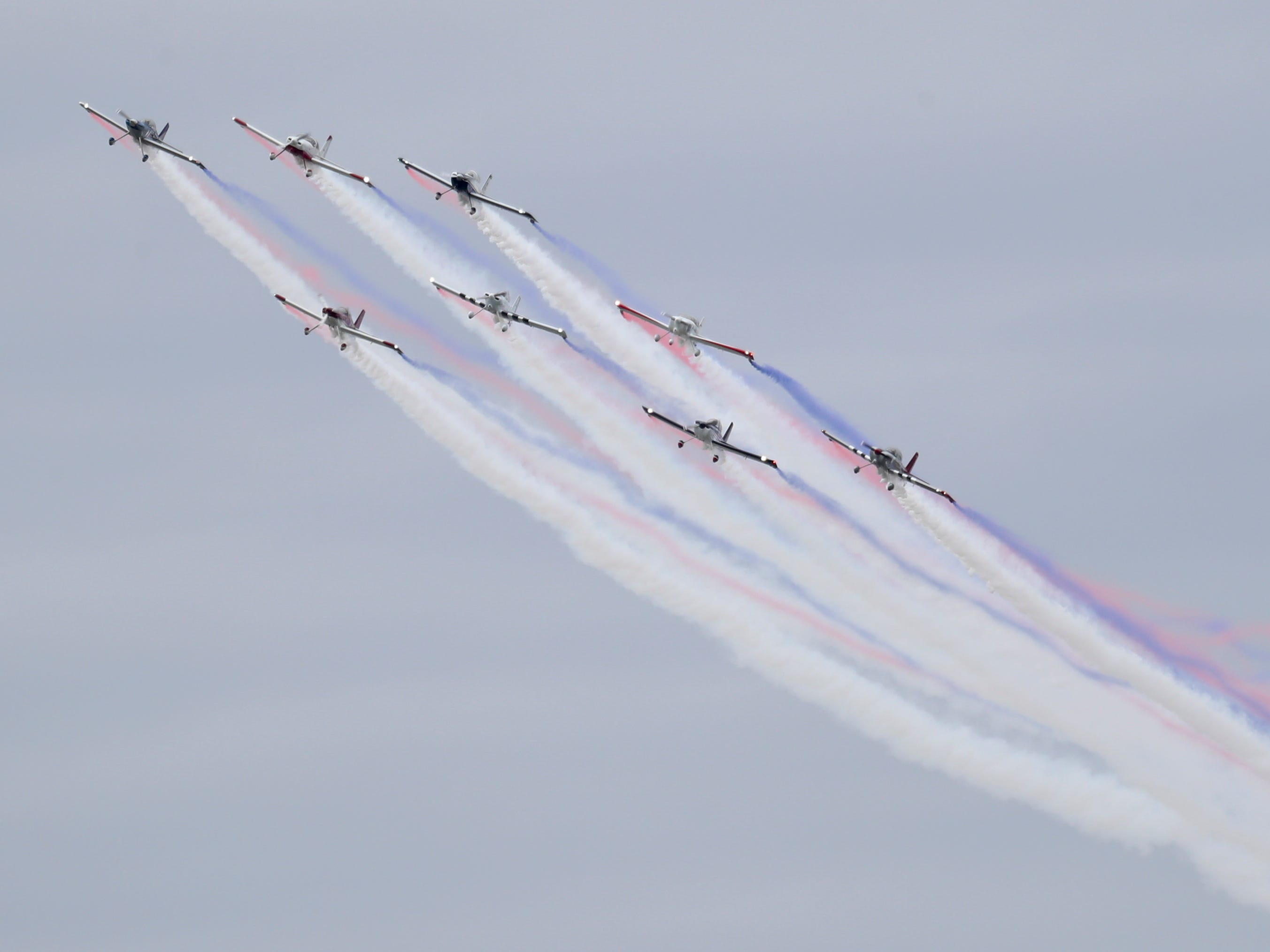 The KC Flight: RV-4 Color Smoke trails entertain the crowd at Thunder Over Louisville on April 13.