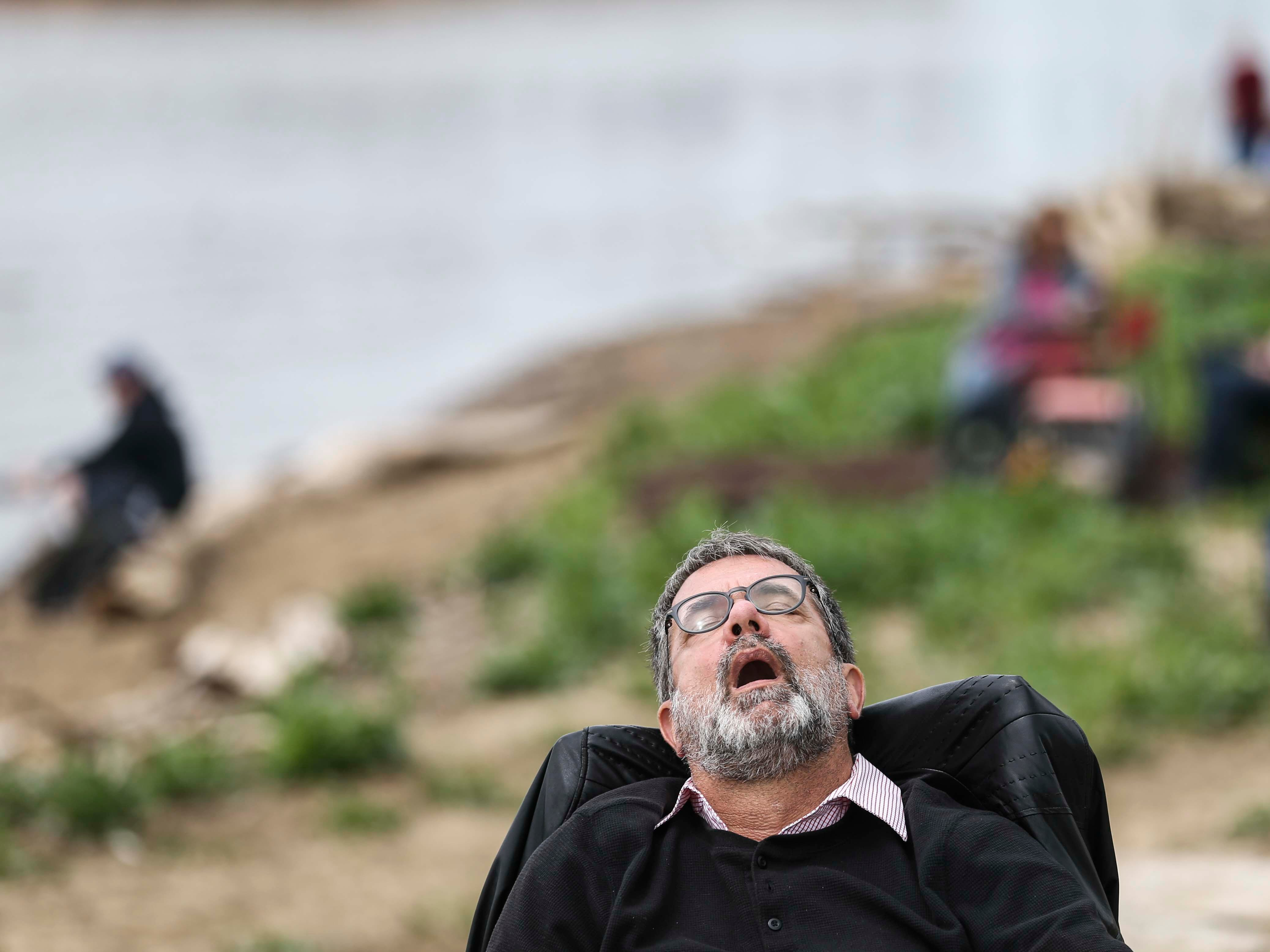 Roland Döring of Germany catches a nap before the start of Thunder Over Louisville from the Indiana riverfront. April 13, 2019