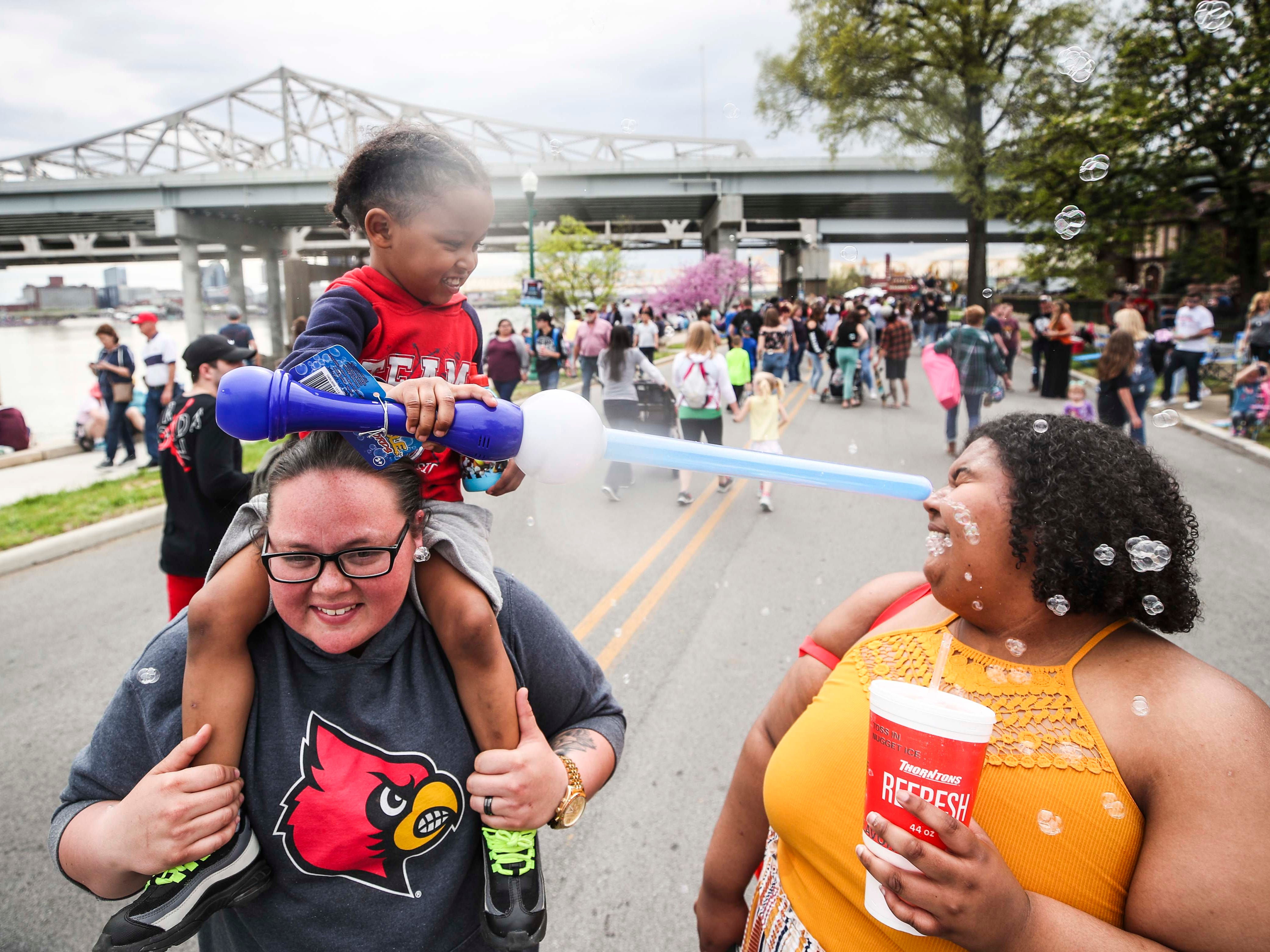 AJ Jones sprays bubbles in the face of his aunt Lydia Jones' face in Jeffersonville during 2019 Thunder Over Louisville. April 13, 2019