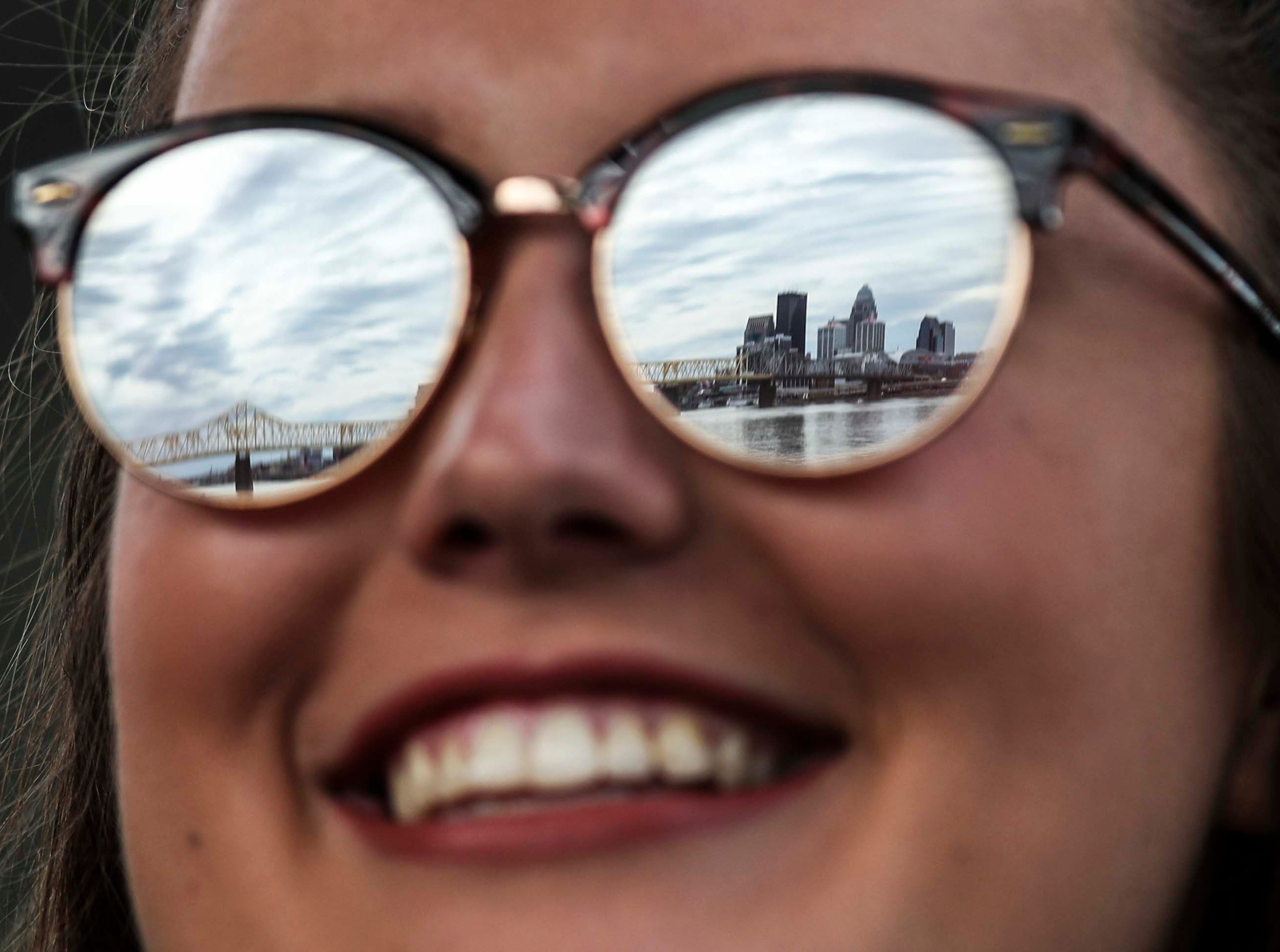 Erin Troy has the skyline of Louisville reflected in her sunglasses as she watches in Jeffersonville during 2019 Thunder Over Louisville. She said she likes the atmosphere better on the Indiana side plus the viewing opportunities. April 13, 2019