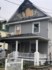 Marion City Firefighters noted 30-foot flames showing from the attic at this house at 150 Boone Avenue early Saturday morning.