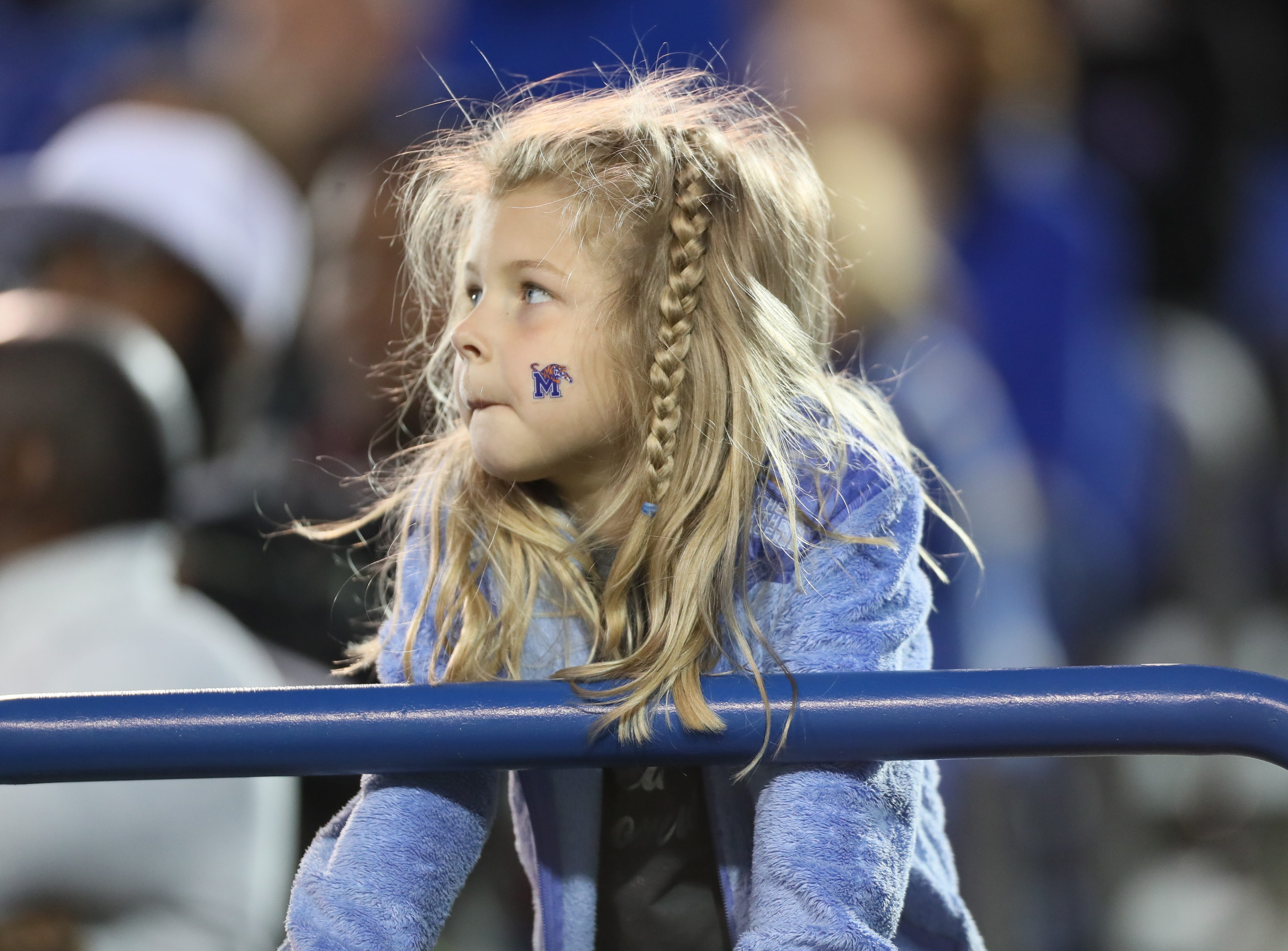 A Memphis Tigers fan watches from the stands during their Friday Night Stripes spring game at Liberty Bowl Memorial Stadium on Friday, April 12, 2019.