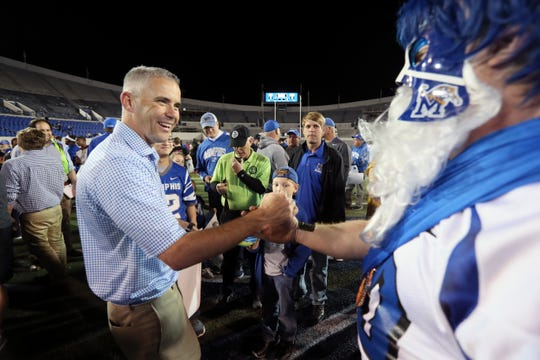 Memphis Tigers Head Coach Mike Norvell greets fans after the Friday Night Stripes spring game at Liberty Bowl Memorial Stadium on Friday, April 12, 2019.