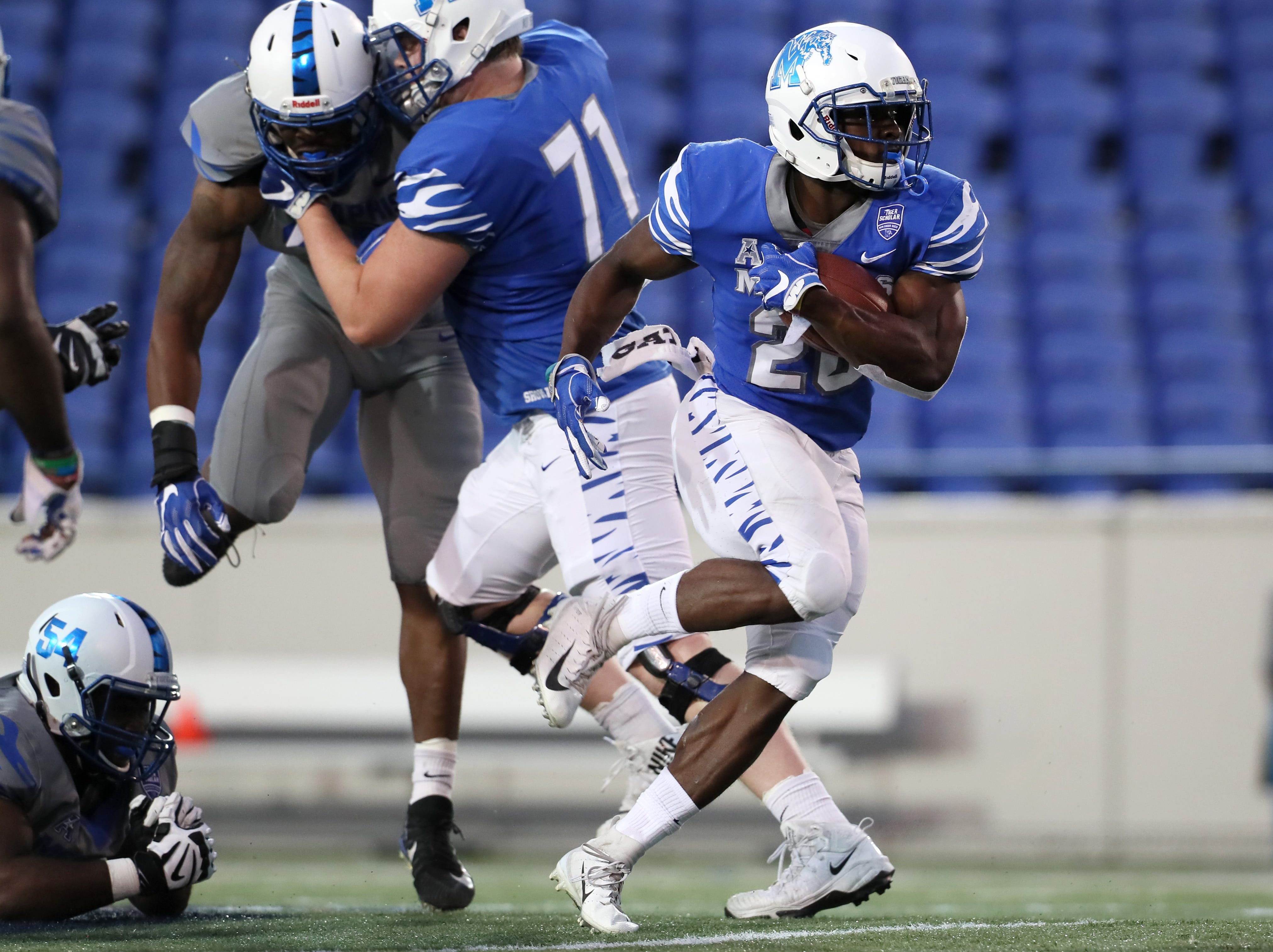 Memphis Tigers running back Marquavius Weaver sprints out of the backfield during their Friday Night Stripes spring game at Liberty Bowl Memorial Stadium on Friday, April 12, 2019.