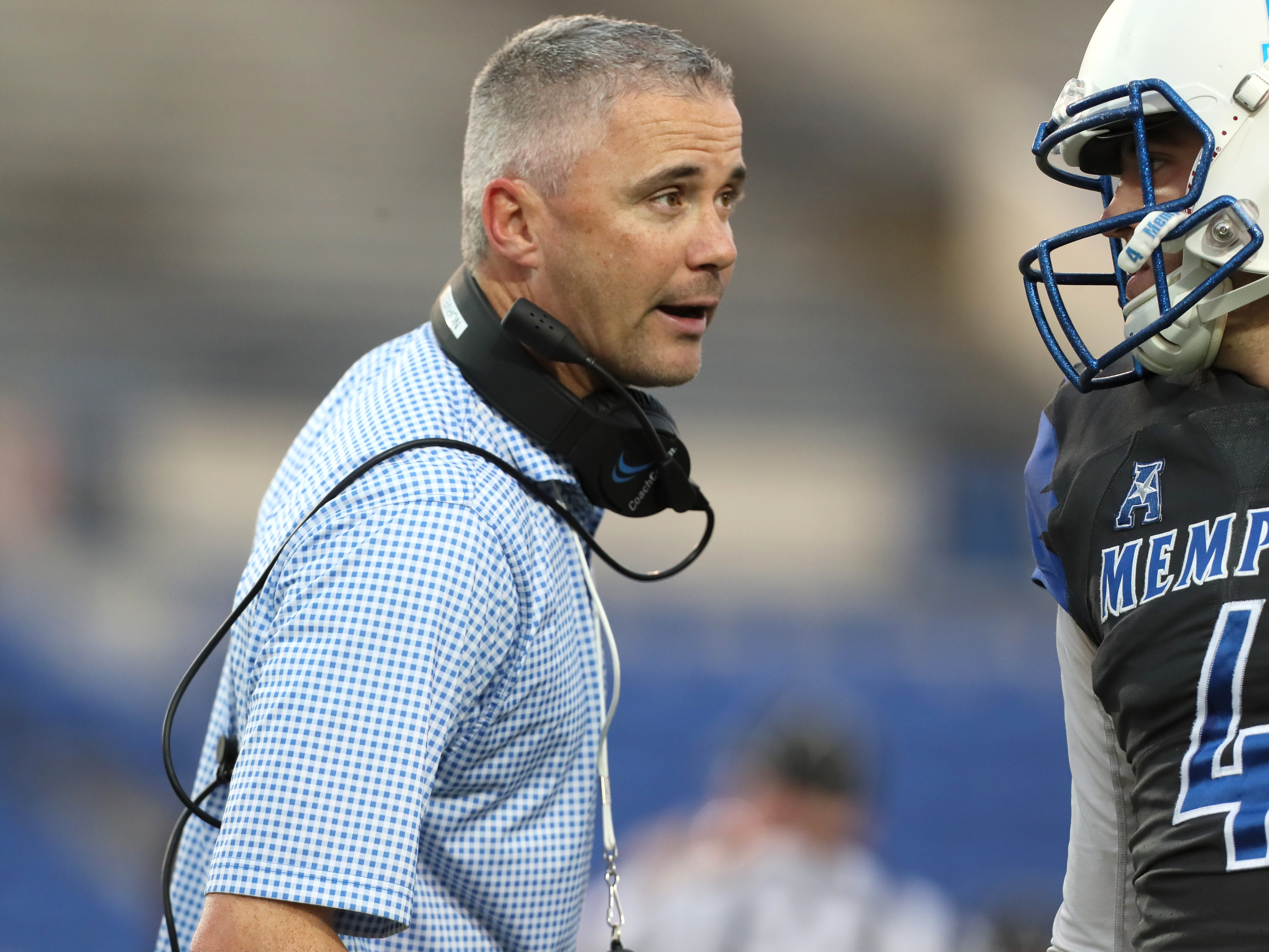 Memphis Tigers Head Coach Mike Norvell talks to quarterback Brady McBride during their Friday Night Stripes spring game at Liberty Bowl Memorial Stadium on Friday, April 12, 2019.