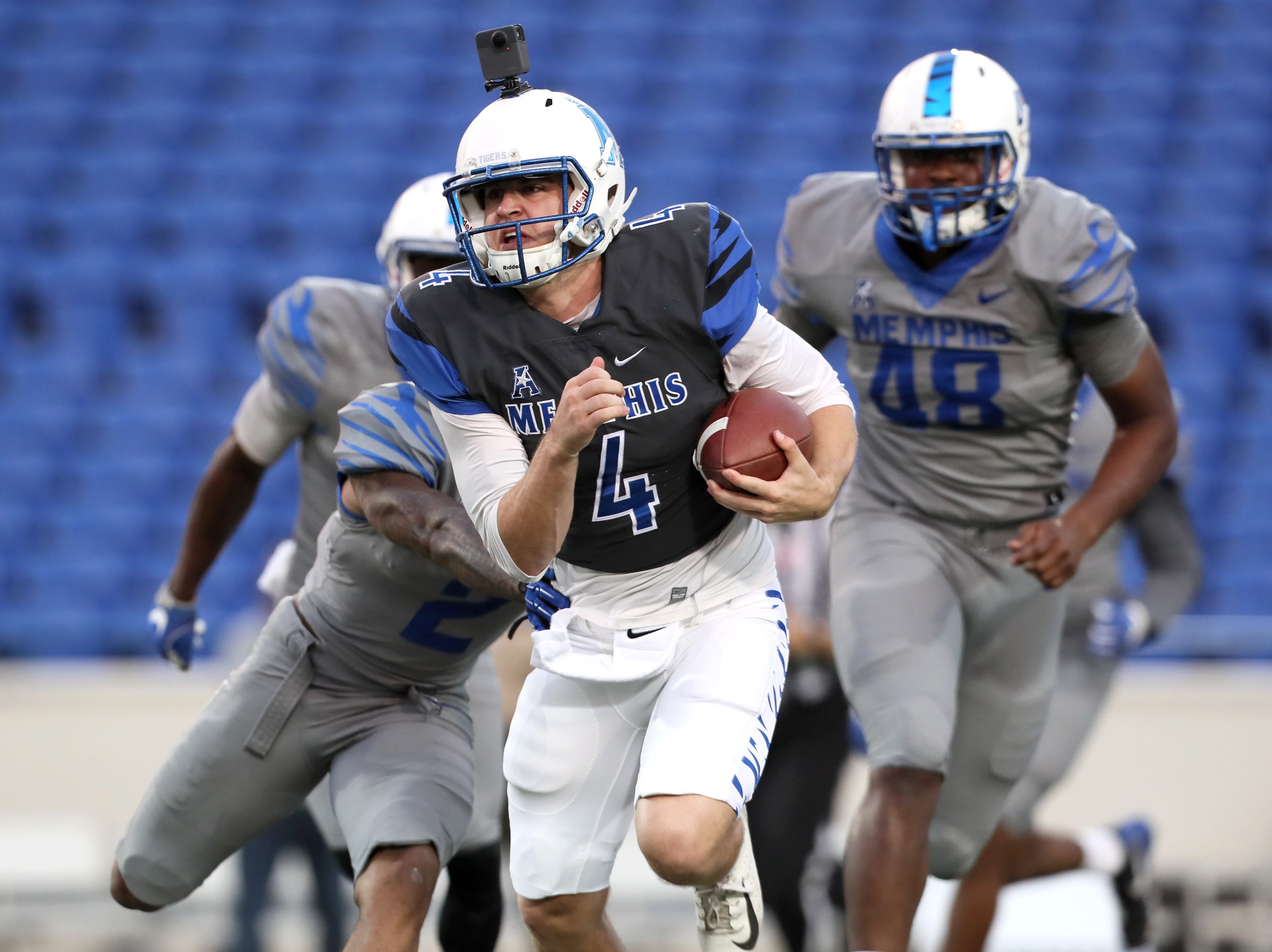 Memphis Tigers quarterback Brady McBride scrambles out of the pocket during their Friday Night Stripes spring game at Liberty Bowl Memorial Stadium on Friday, April 12, 2019.