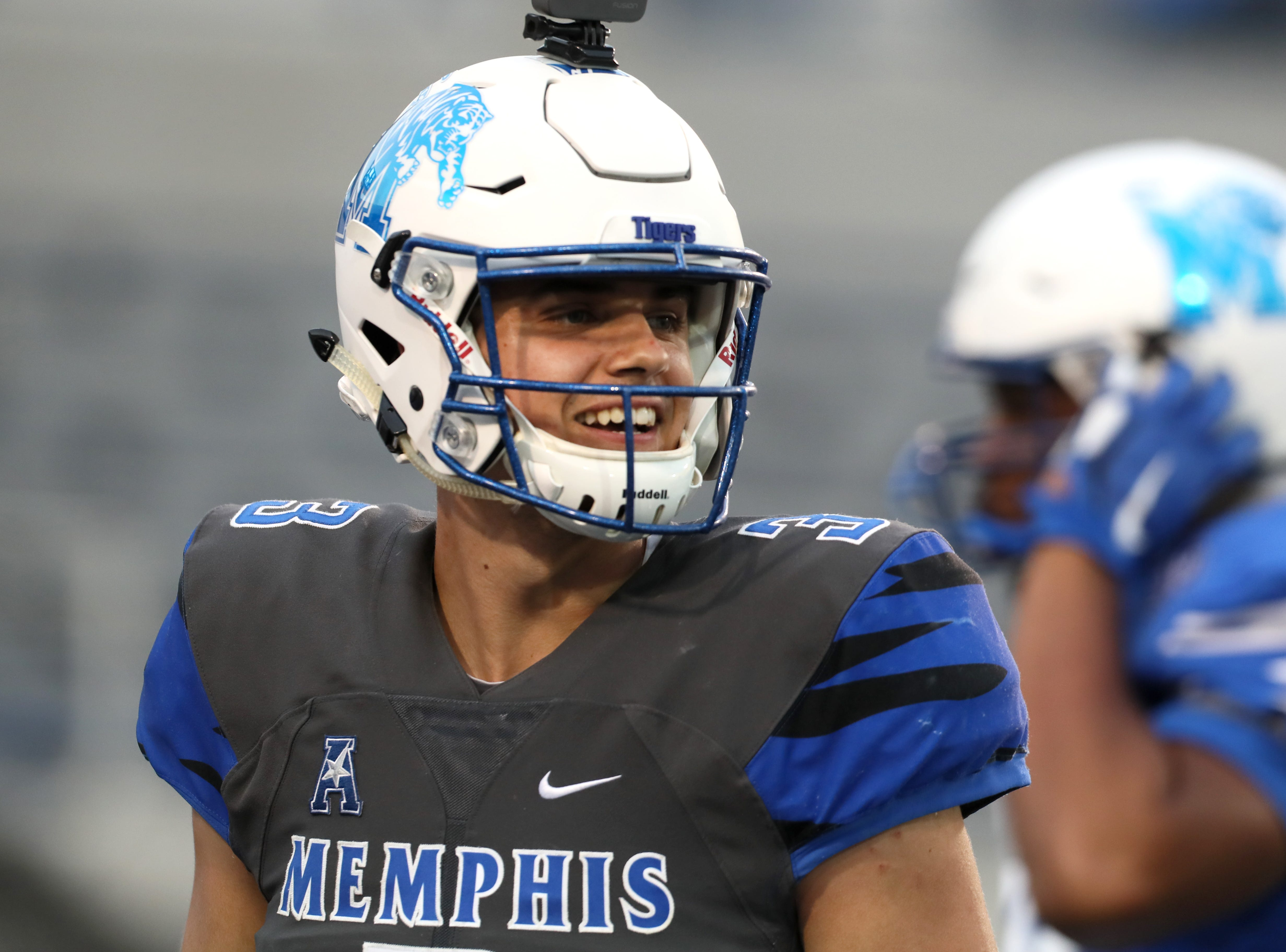 Memphis Tigers quarterback Brady White smiles after a touchdown play during their Friday Night Stripes spring game at Liberty Bowl Memorial Stadium on Friday, April 12, 2019.