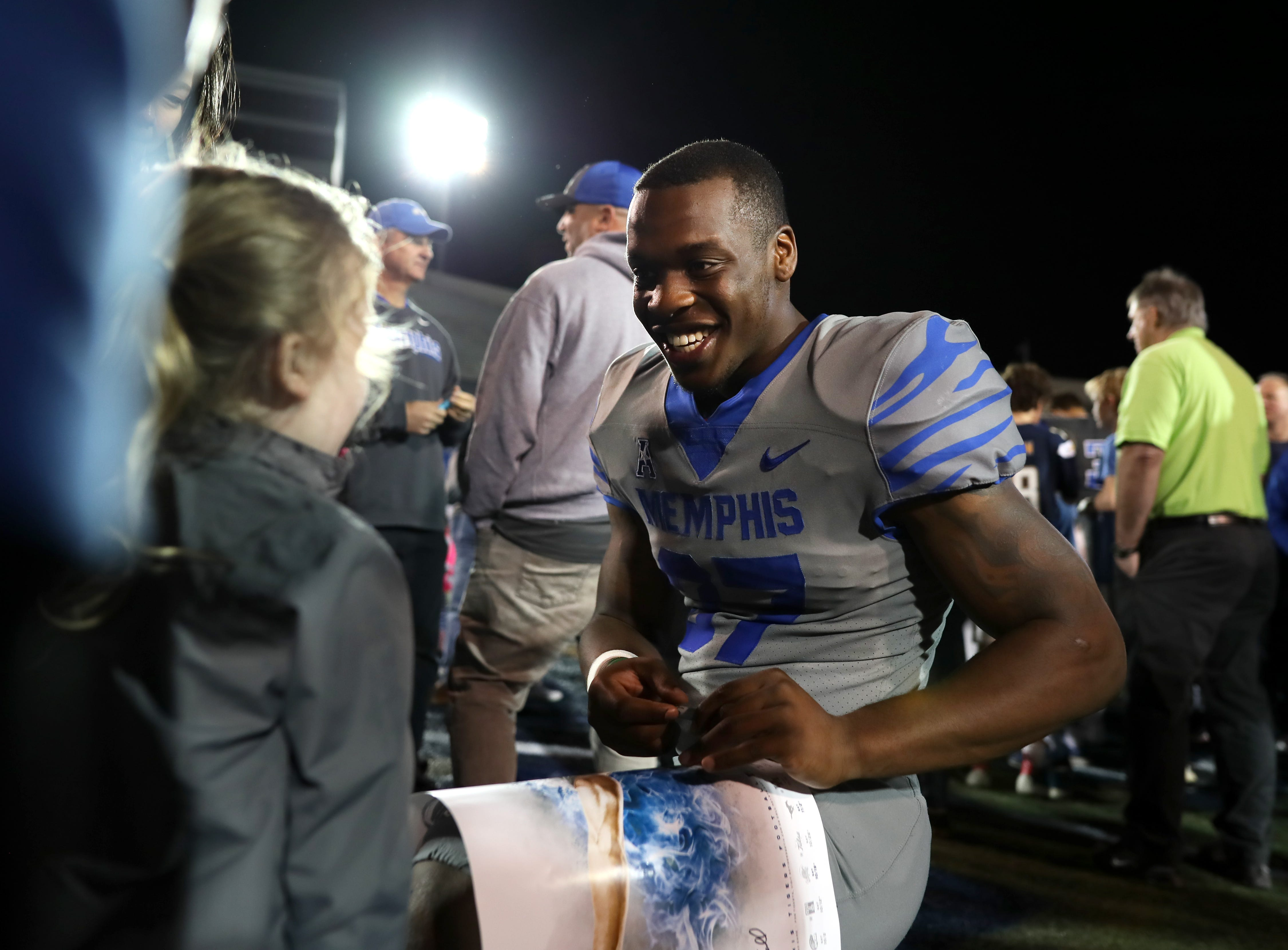 Memphis Tigers Jaylon Allen signs autographs for fans after their Friday Night Stripes spring game at Liberty Bowl Memorial Stadium on Friday, April 12, 2019.