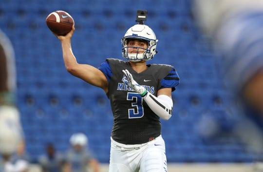 Memphis Tigers quarterback Brady White throws the ball during their Friday Night Stripes spring game at Liberty Bowl Memorial Stadium on Friday, April 12, 2019.