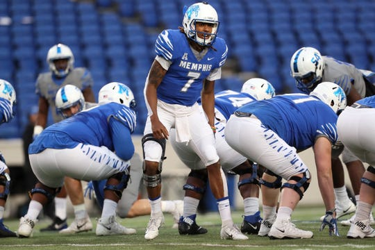 Memphis Tigers quarterback Markevion Quinn yells out a call to his teammates during their Friday Night Stripes spring game at Liberty Bowl Memorial Stadium on Friday, April 12, 2019.