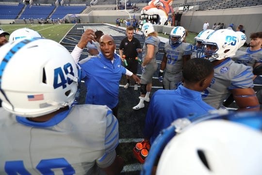 Memphis Tigers defensive line coach Tim Edwards talks to his players during their Friday Night Stripes spring game at Liberty Bowl Memorial Stadium on Friday, April 12, 2019.