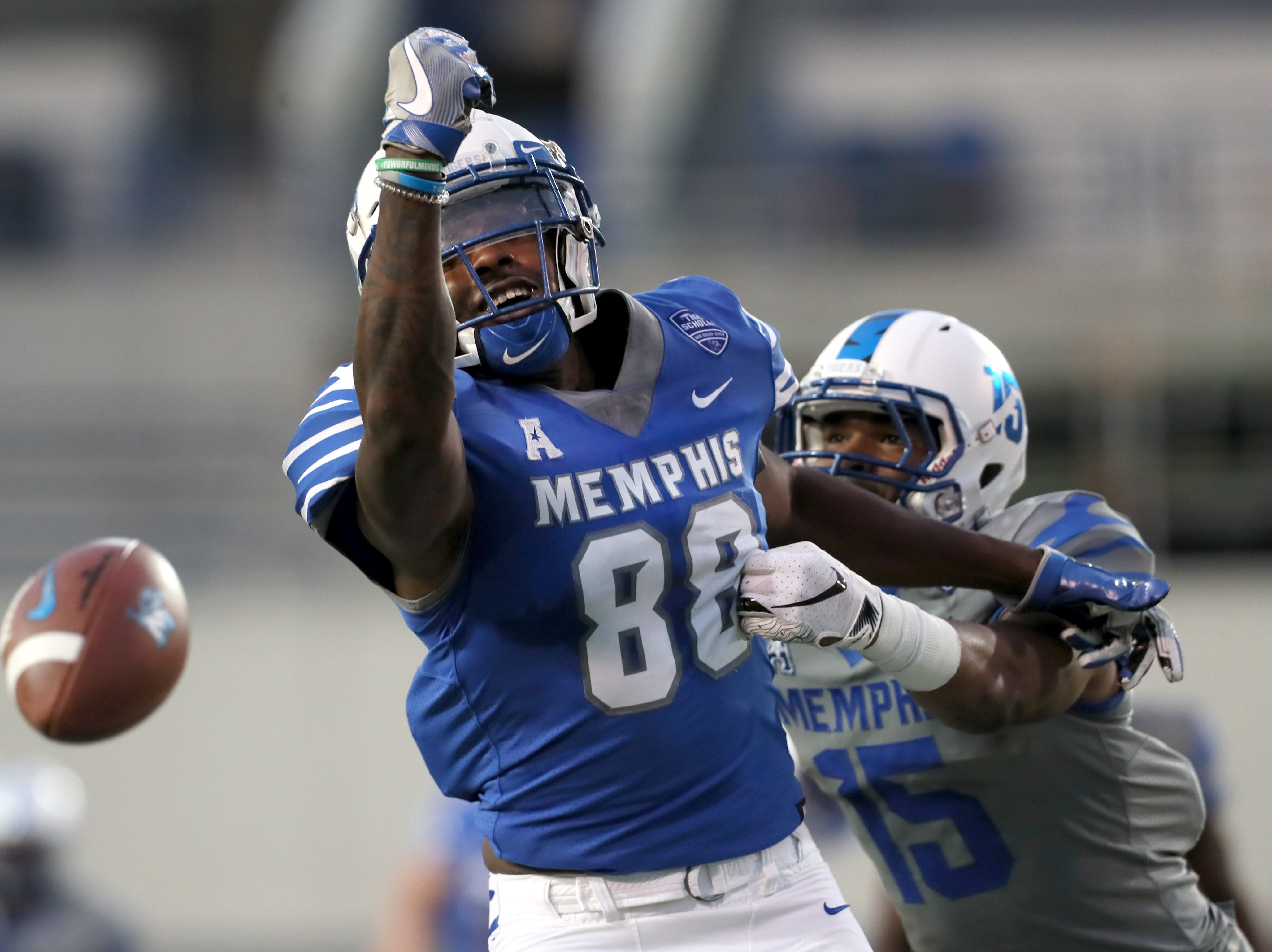 Memphis Tigers tight end Tyce Daniel stretches out, coming up just short on a catch during their Friday Night Stripes spring game at Liberty Bowl Memorial Stadium on Friday, April 12, 2019.
