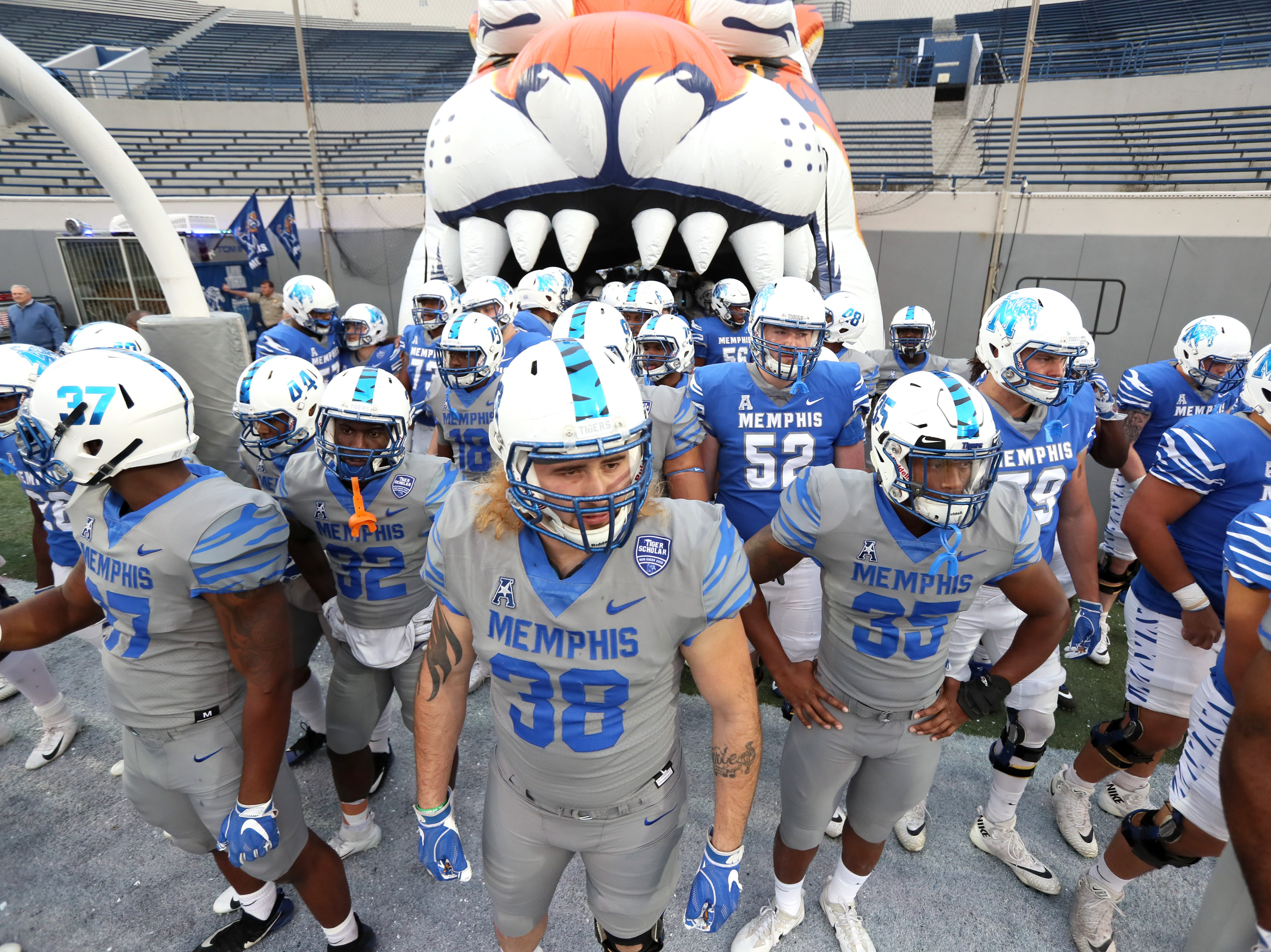 Memphis Tigers players wait to charge out on to the field during their Friday Night Stripes spring game at Liberty Bowl Memorial Stadium on Friday, April 12, 2019.