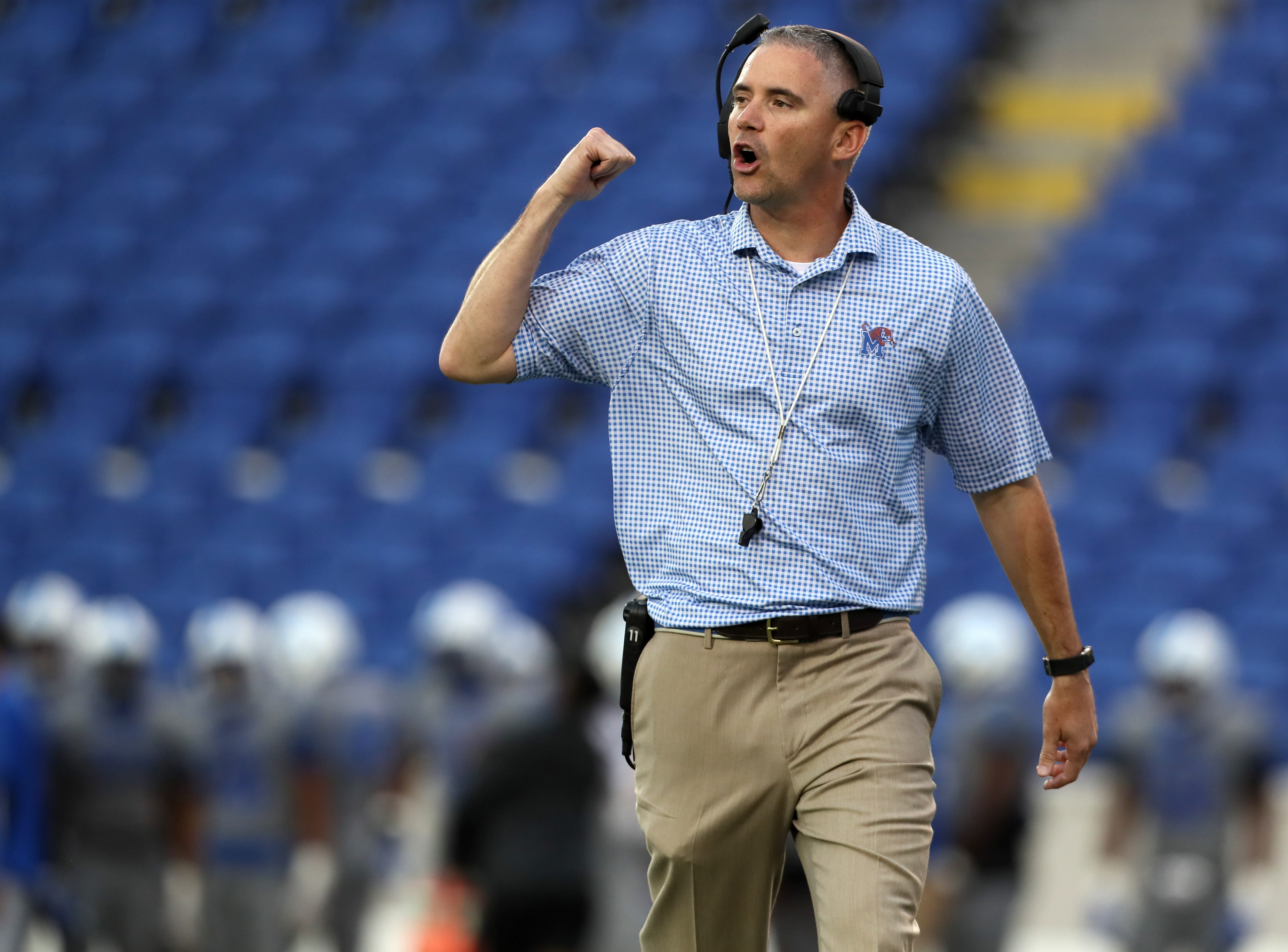 Memphis Tigers Head Coach Mike Norvell talks to his team during their Friday Night Stripes spring game at Liberty Bowl Memorial Stadium on Friday, April 12, 2019.