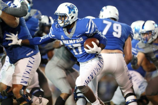 Memphis Tigers wide receiver Kylan Watkins takes the ball out of the backfield during their Friday Night Stripes spring game at Liberty Bowl Memorial Stadium on Friday, April 12, 2019.