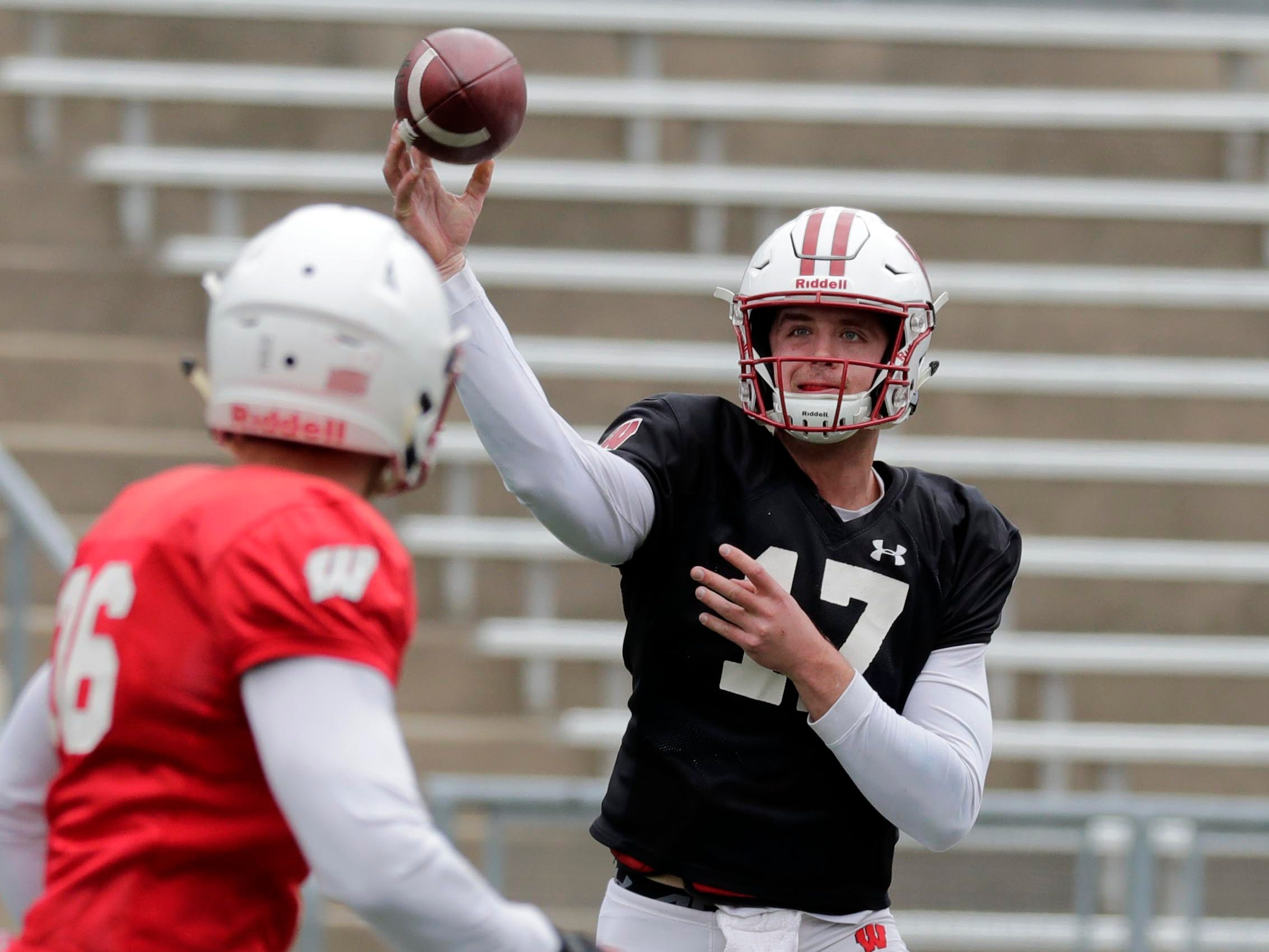 Quarterback Jack Coan finds an open receiver during practice.