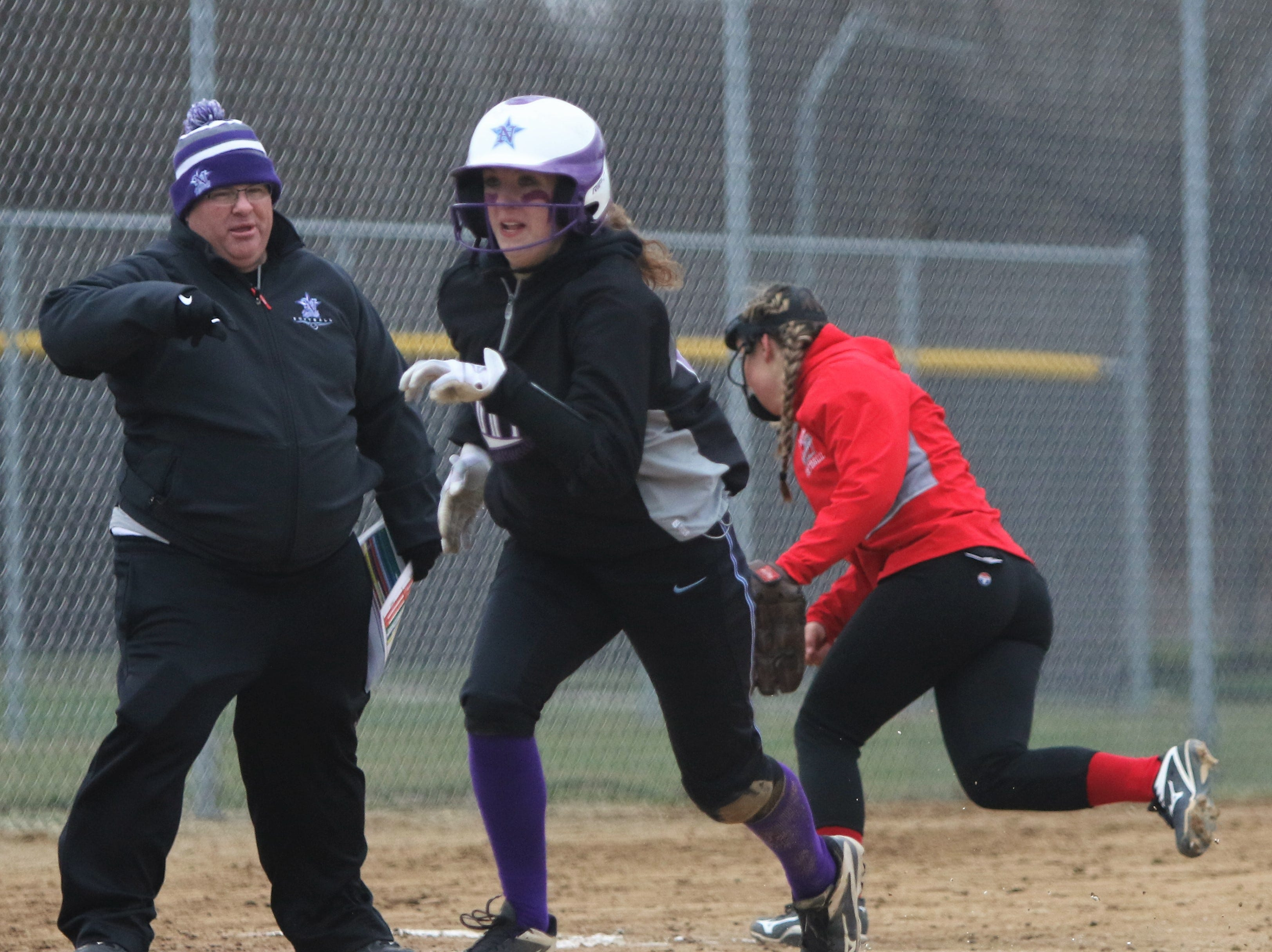 Waukesha North's Jenny Gibbs heads toward home plate on an overthrow of third base by Muskego.