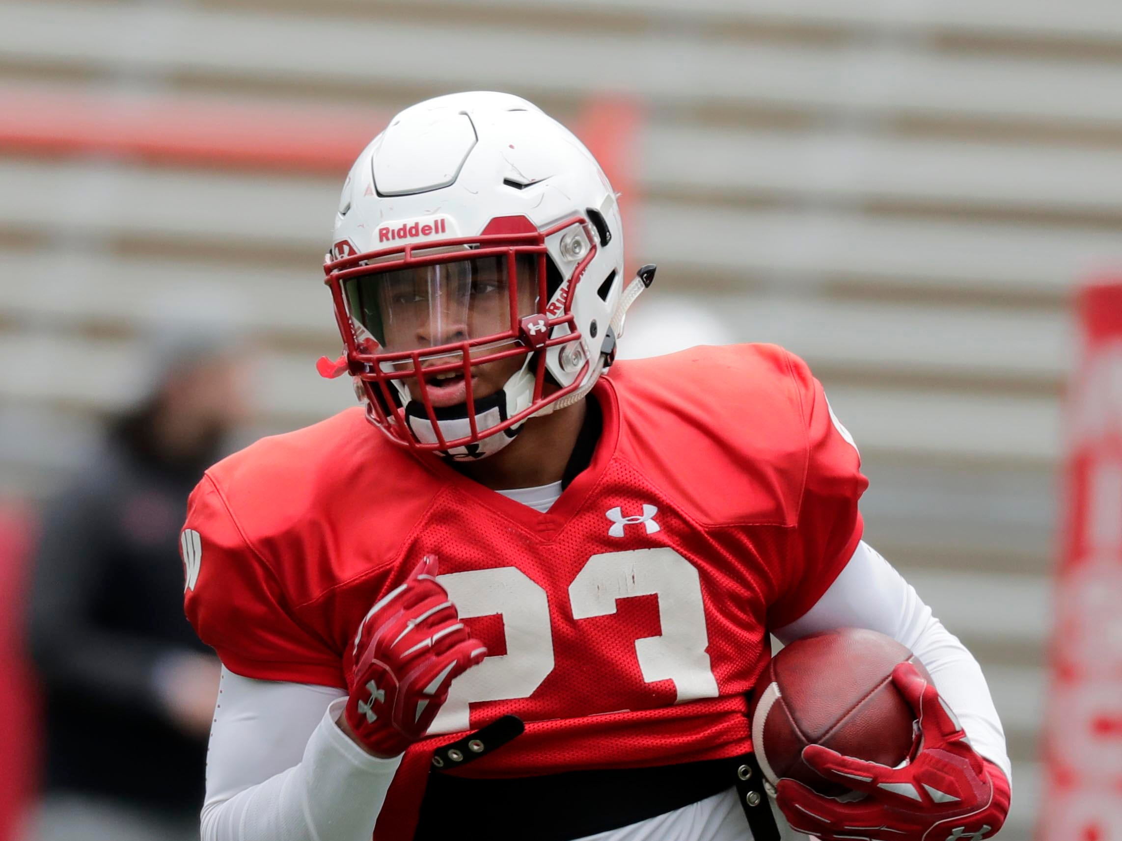 UW running back Jonathan Taylor finds room to run during practice Saturday.