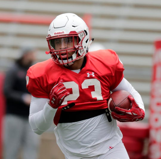 UW running back Jonathan Taylor finds room to run during a spring practice.