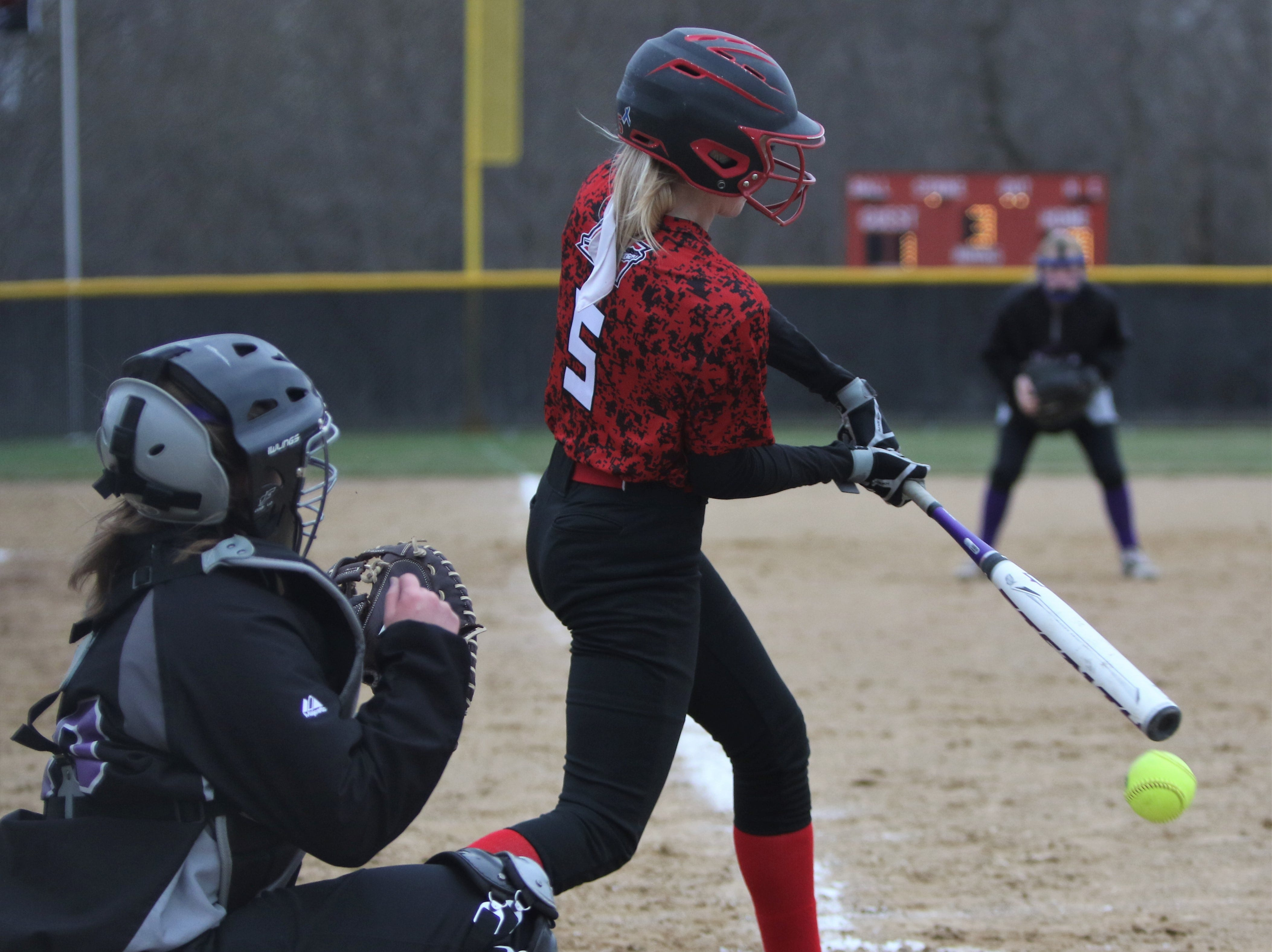 Muskego's Makayla Terrence pounds a ground ball into the dirt against Waukesha North on April 12, 2019.