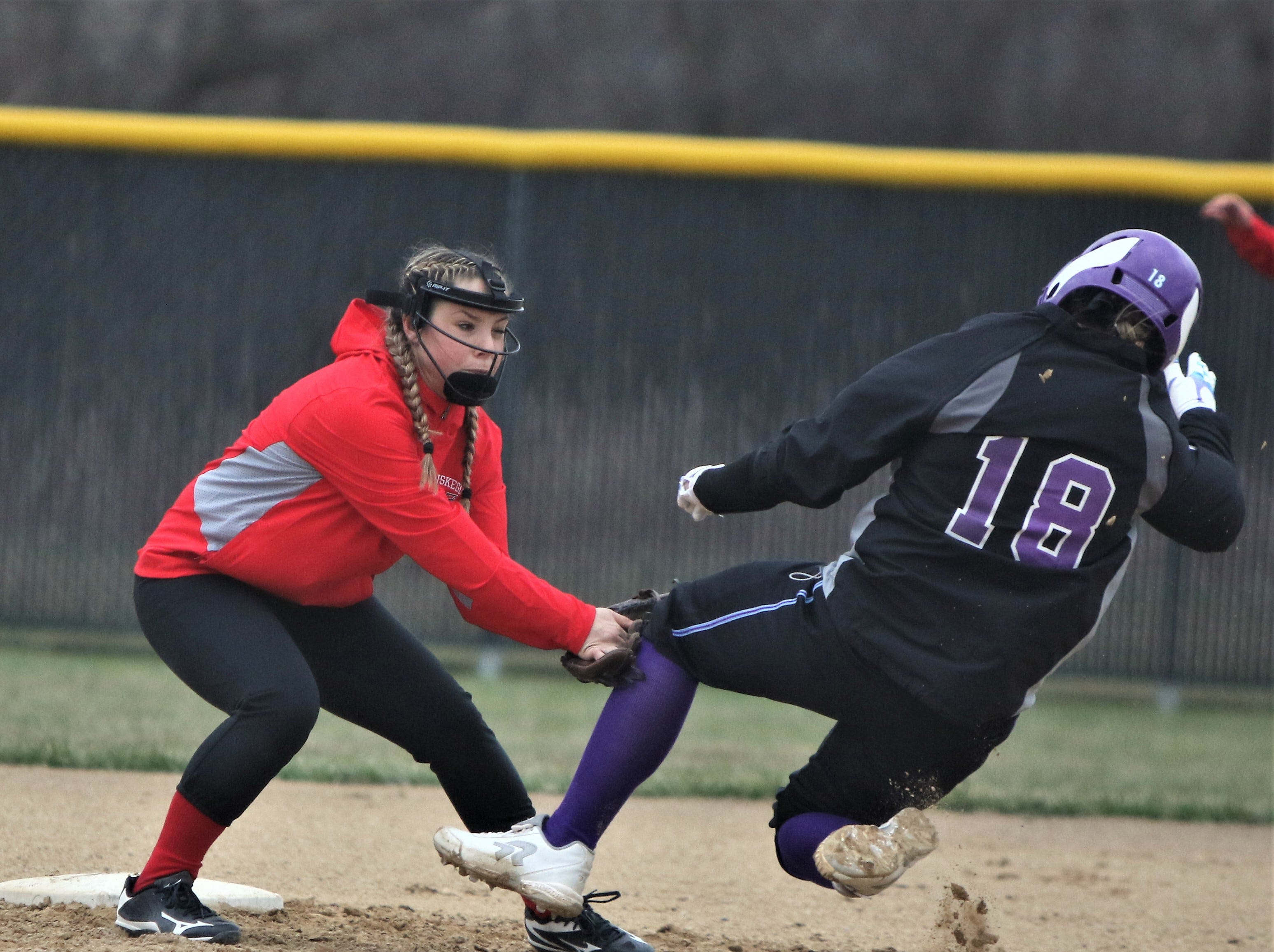 Waukesha North senior Maddy Anderson (18) is tagged out trying to steal second base against Muskego on April 12, 2019.