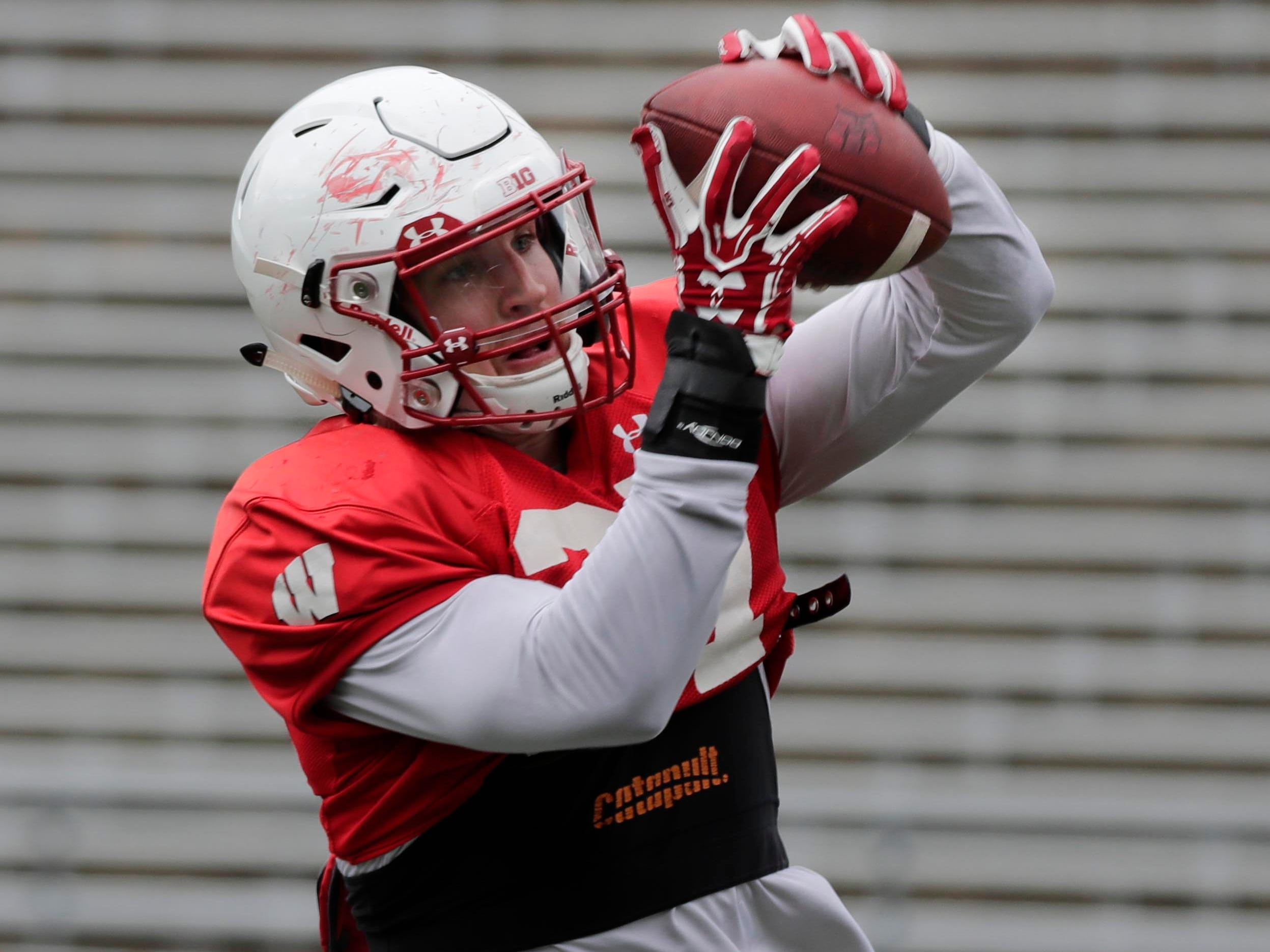 Wisconsin running back Garrett Groshek hauls in a pass during Saturday's spring practice.