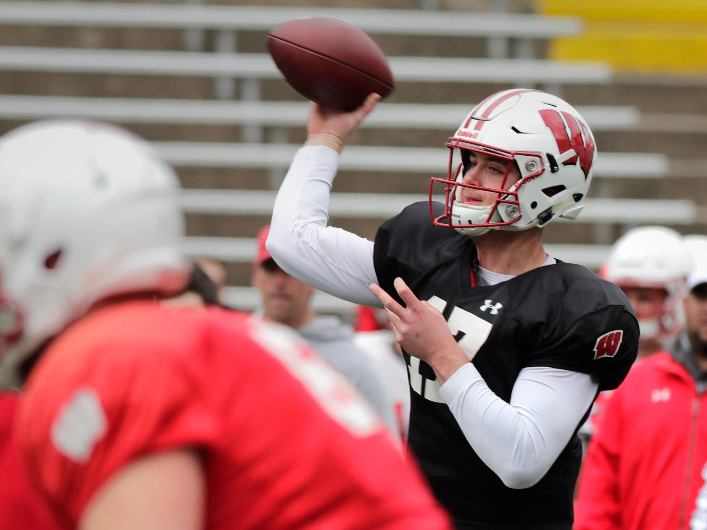 Quarterback Jack Coan gets ready to unleash a pass during UW's spring practice Saturday at Camp Randall Stadium.