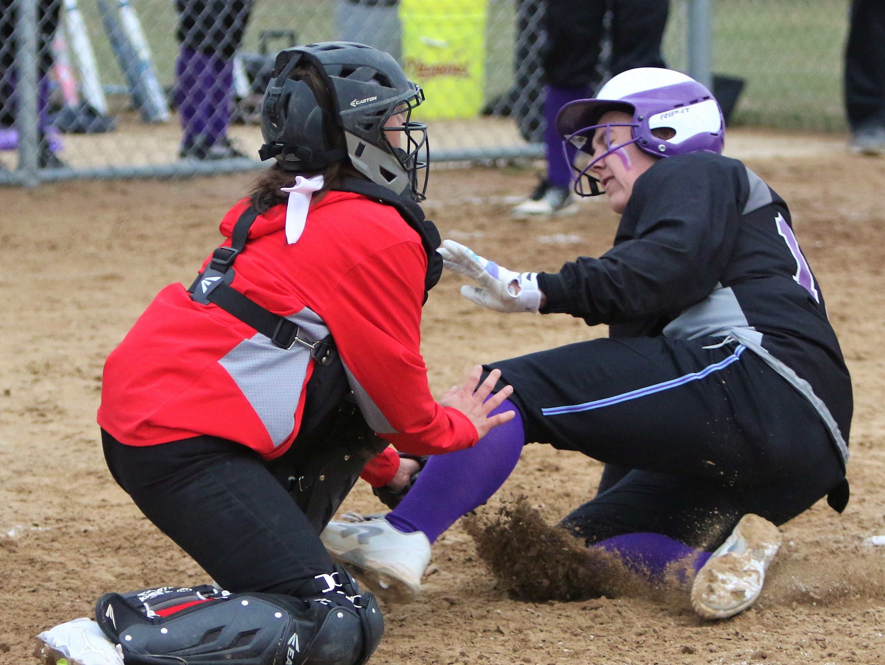 Waukesha North senior Maddy Anderson is tagged out at home plate against Muskego on April 12, 2019.