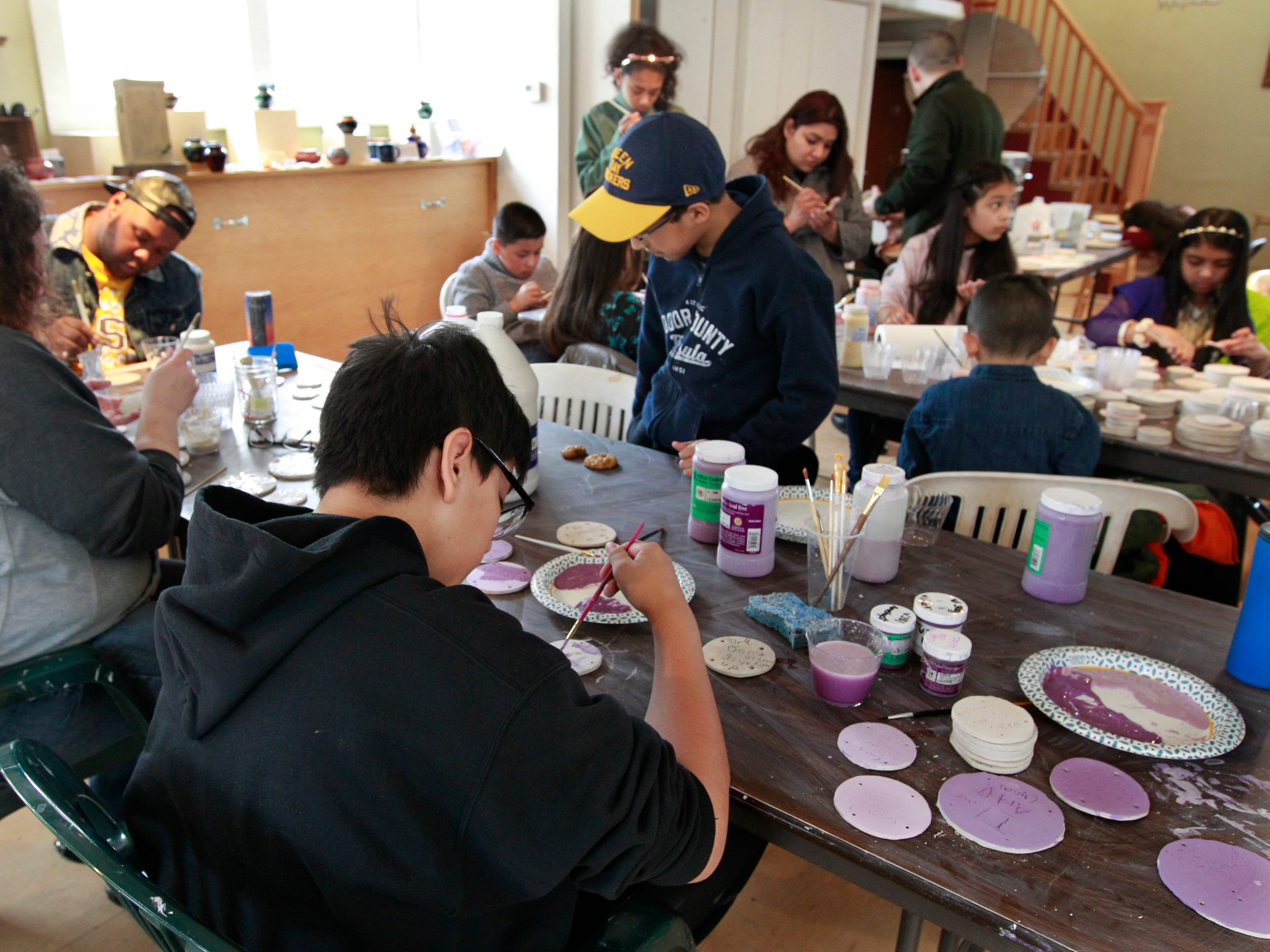 The art studio of Lori Gramling is filled with students and adults on a Saturday   working on a community art project.
