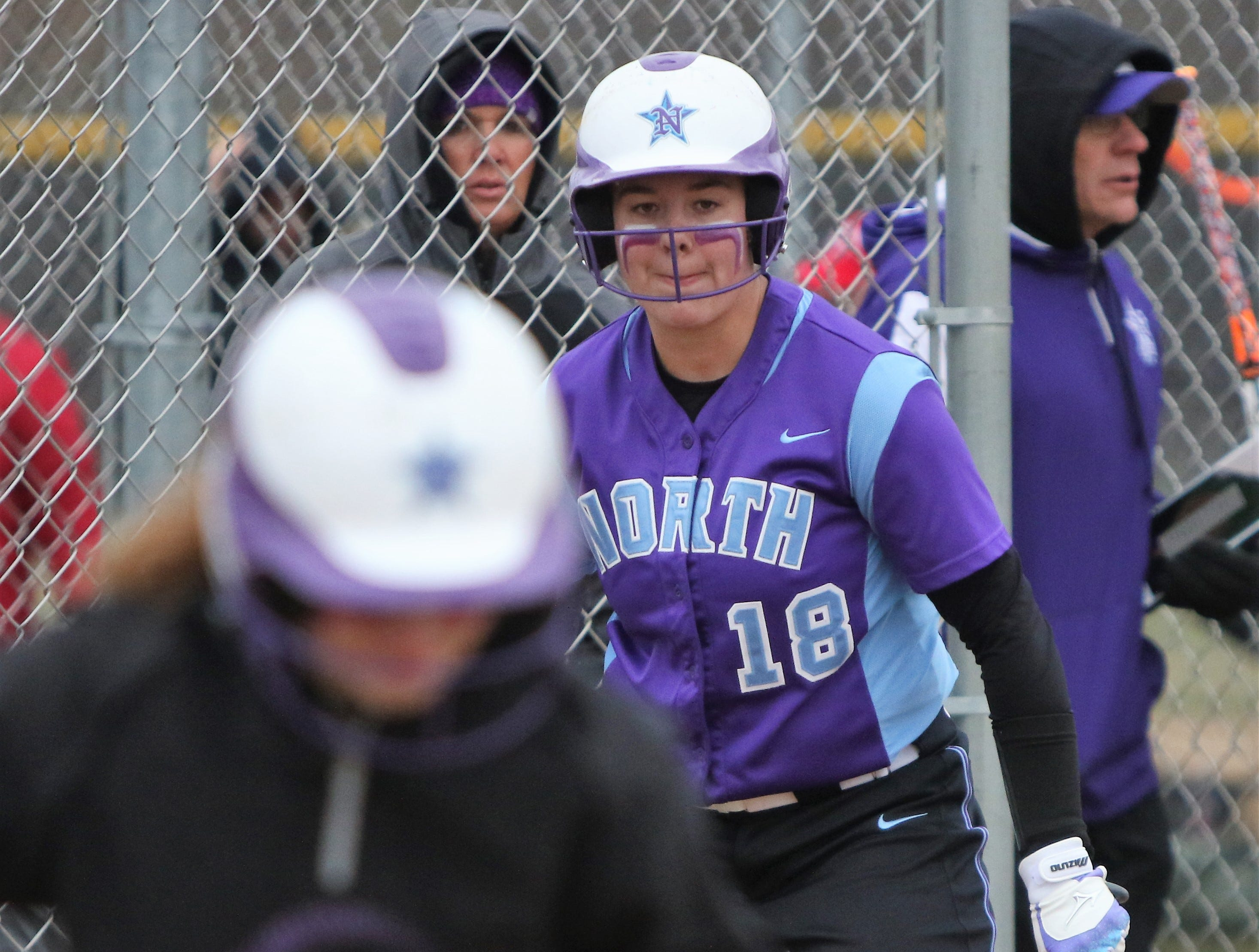 Waukesha North senior Maddy Anderson watches on from the on deck circle against Muskego on April 12, 2019.