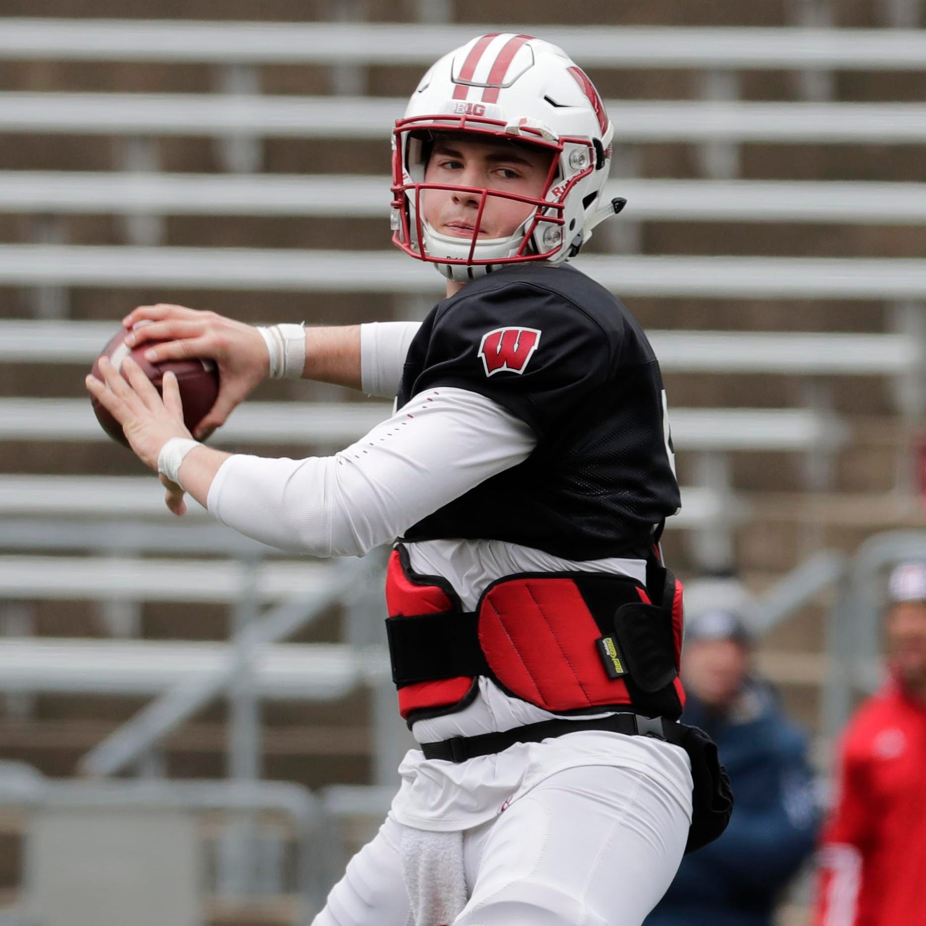 UW's returning quarterbacks have embraced the newcomer, All-American Graham Mertz