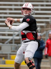 Quarterback Graham Mertz warms up before a recent practice.