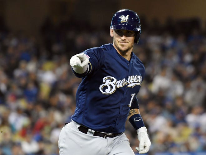Brewers catcher Yasmani Grandal  rounds the bases after hitting a two-run home run against the Dodgers during the fifth inning.