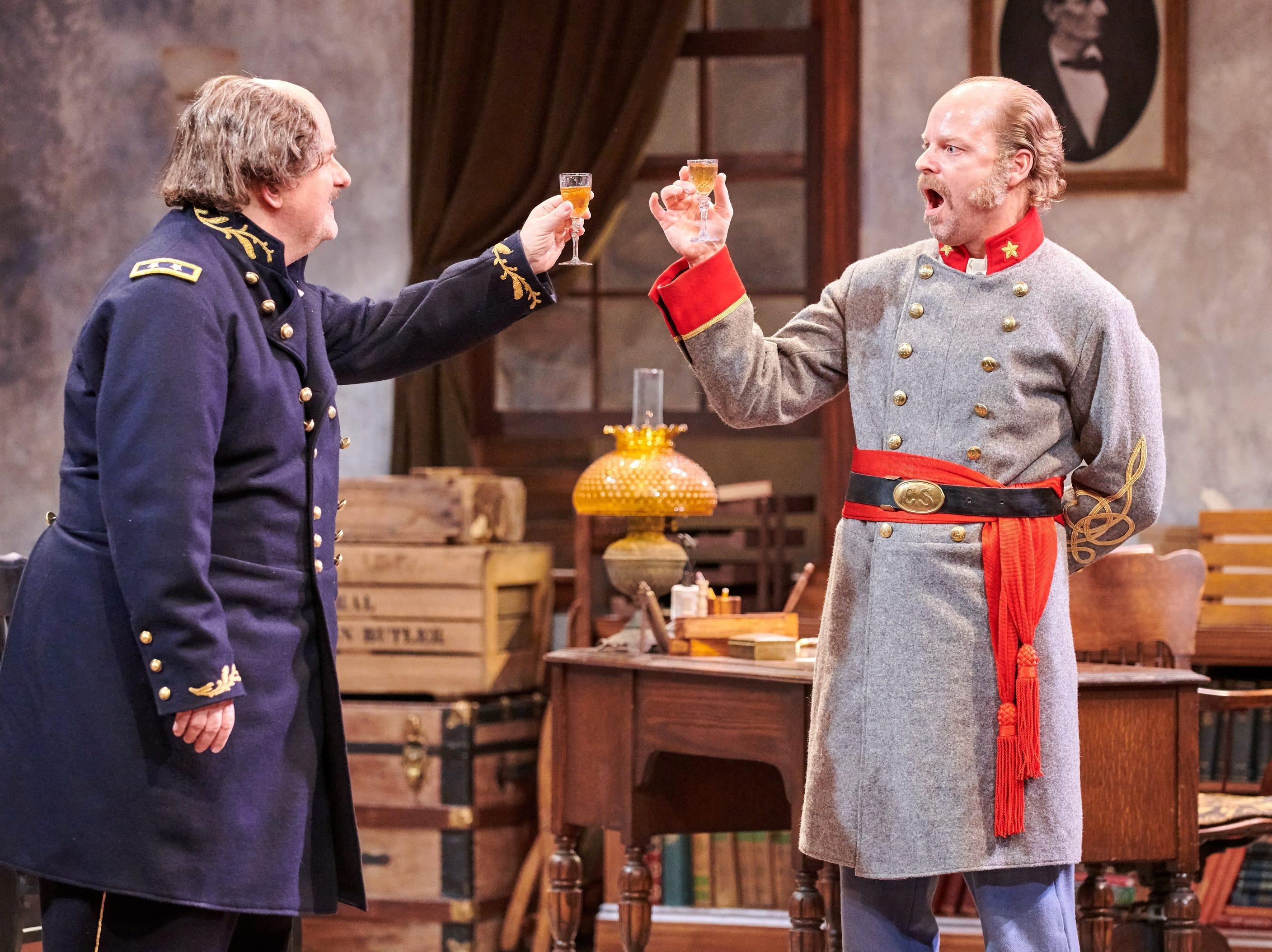 "Drew Brhel (left) and David Sapiro clink glasses in Milwaukee Chamber Theatre's ""Ben Butler."""
