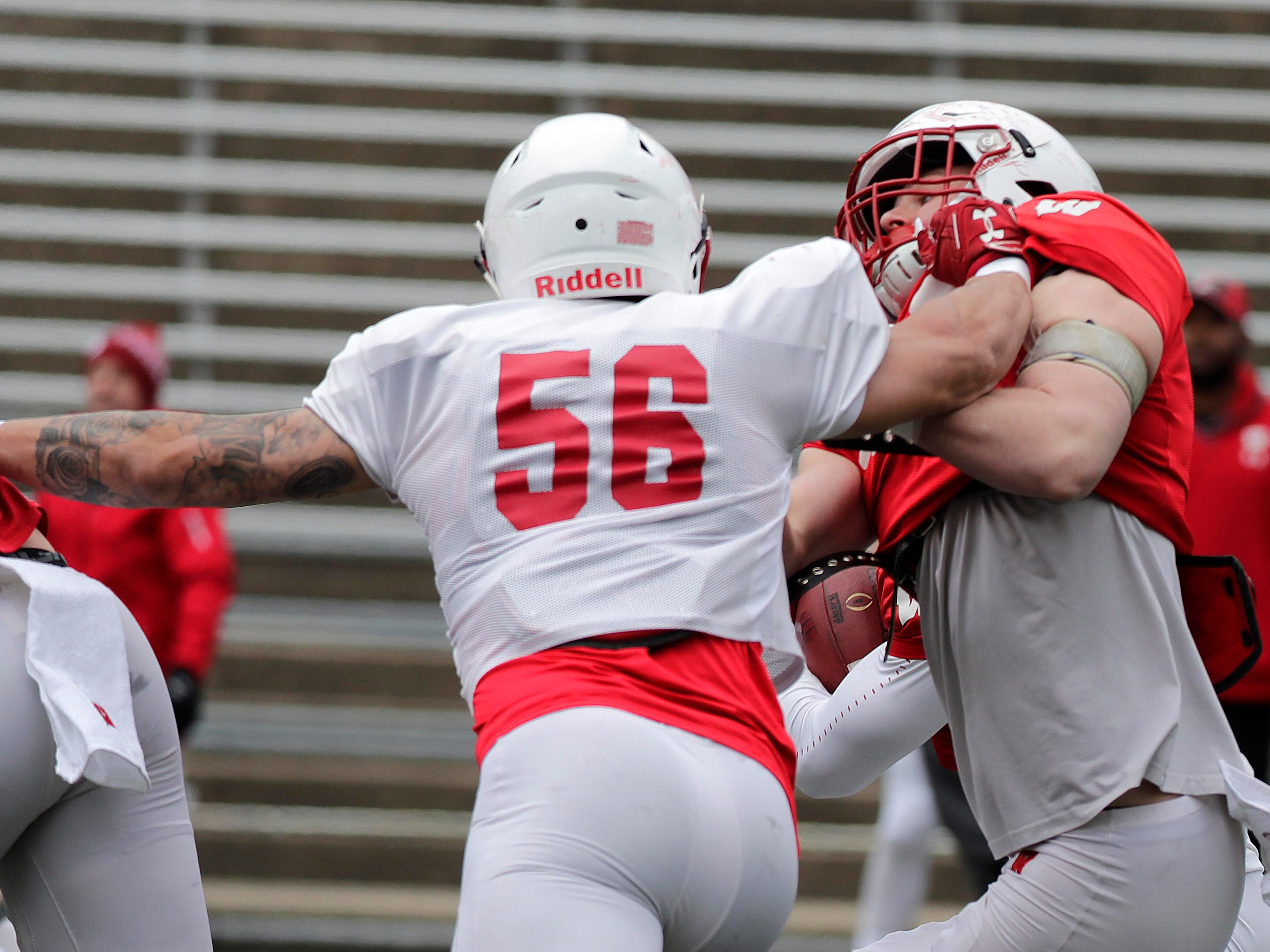 Outside linebacker Zack Baun gets the upper hand on a blocker as he rushes the quarterback during Saturday's open spring practice.