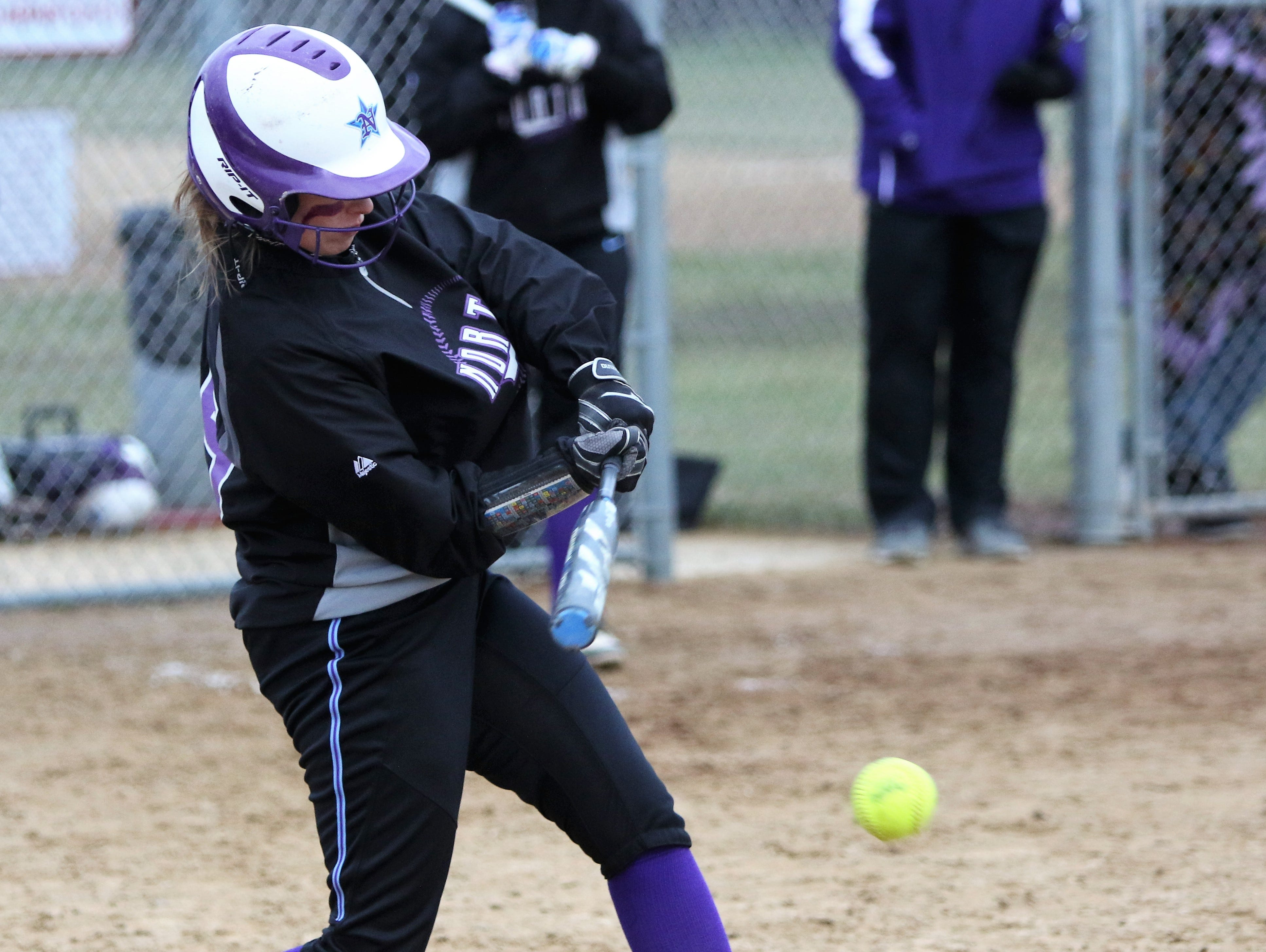 Waukesha North senior Liz Sweet hits a grounder against Muskego on April 12, 2019.